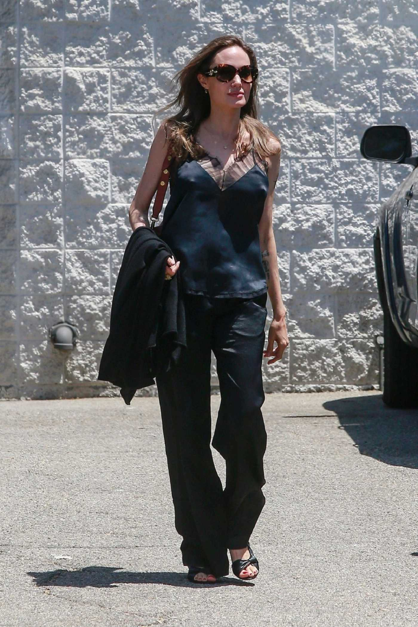 Angelina Jolie in a Black Blouse Was Seen Out in Los Angeles 07/26/2019