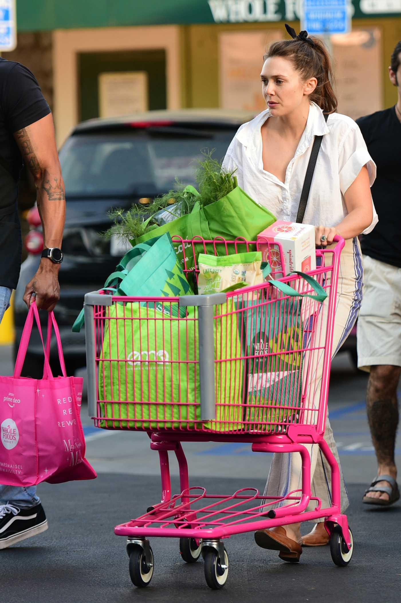 Elizabeth Olsen in a Beige Striped Pants Goes Shopping for Groceries at Whole Foods Market in Sherman Oaks 07/25/2019