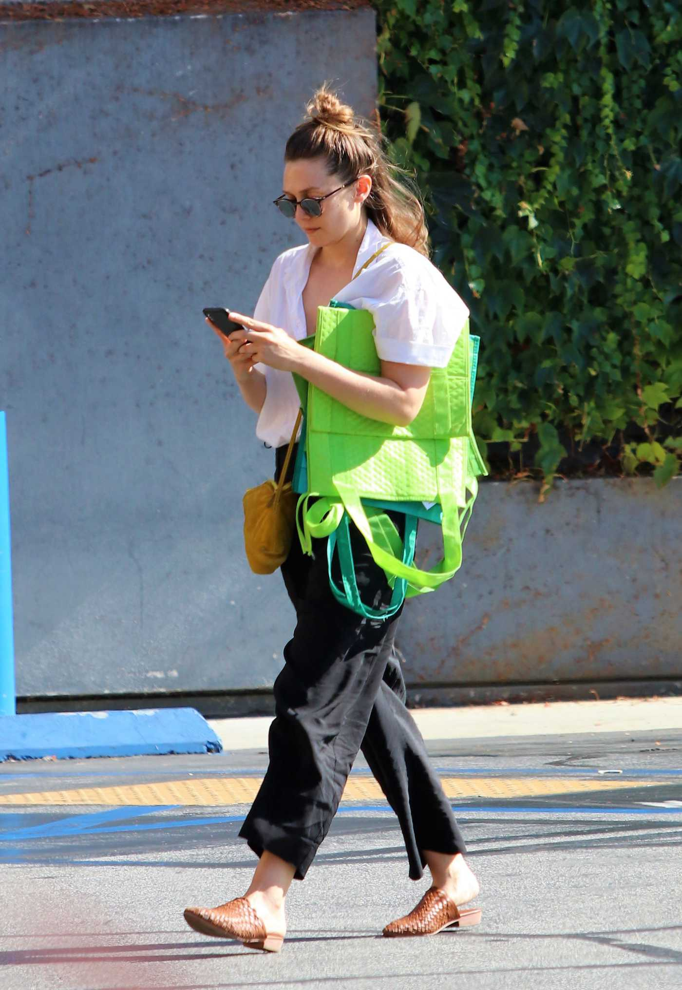 Elizabeth Olsen in a White Blouse Goes Grocery Shopping at Gleason's Market in LA 07/12/2019