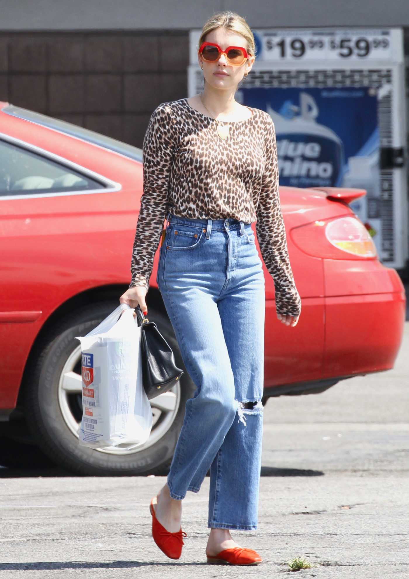 Emma Roberts in a Leopard Print Blouse Leaves a Rite Aid Store in Los Feliz 07/07/2019