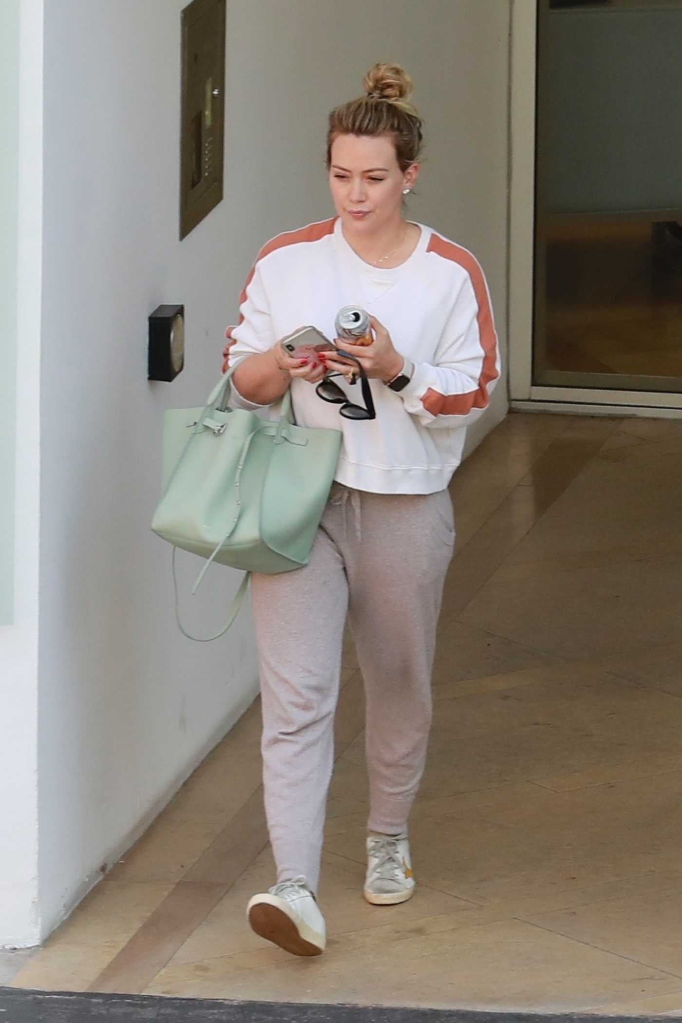 Hilary Duff in a Beige Sweatpants Arrives to a Medical Building in Beverly Hills 07/09/2019