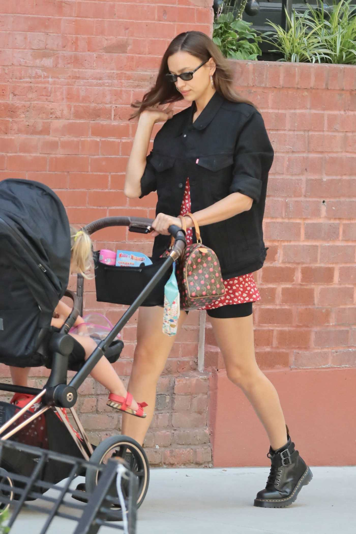 Irina Shayk in a Black Denim Jacket Was Seen Out with Her Daughter in New York City 07/15/2019