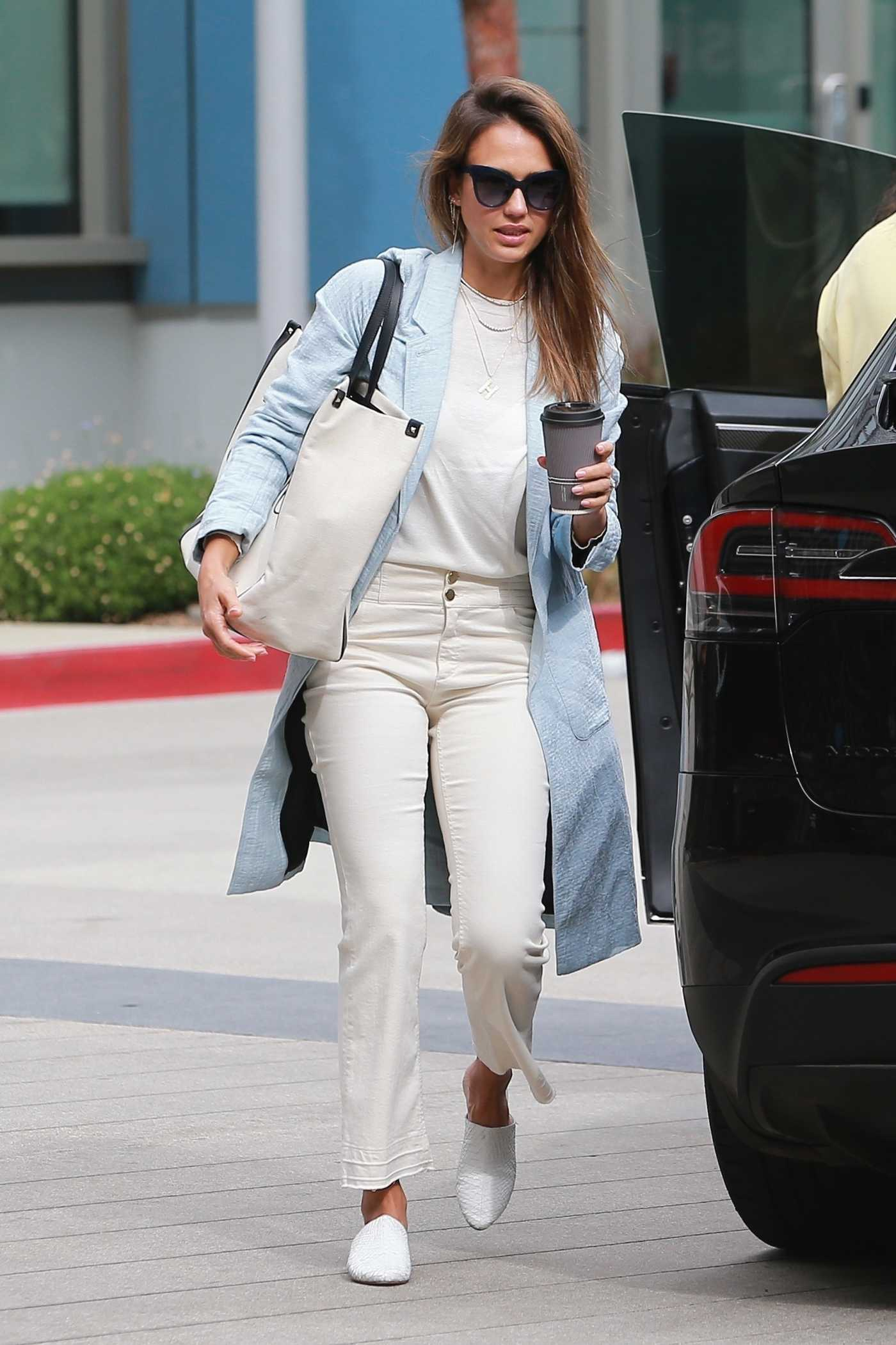 Jessica Alba in a Blue Trench Coat Heads to Her Office in Los Angeles 07/09/2019
