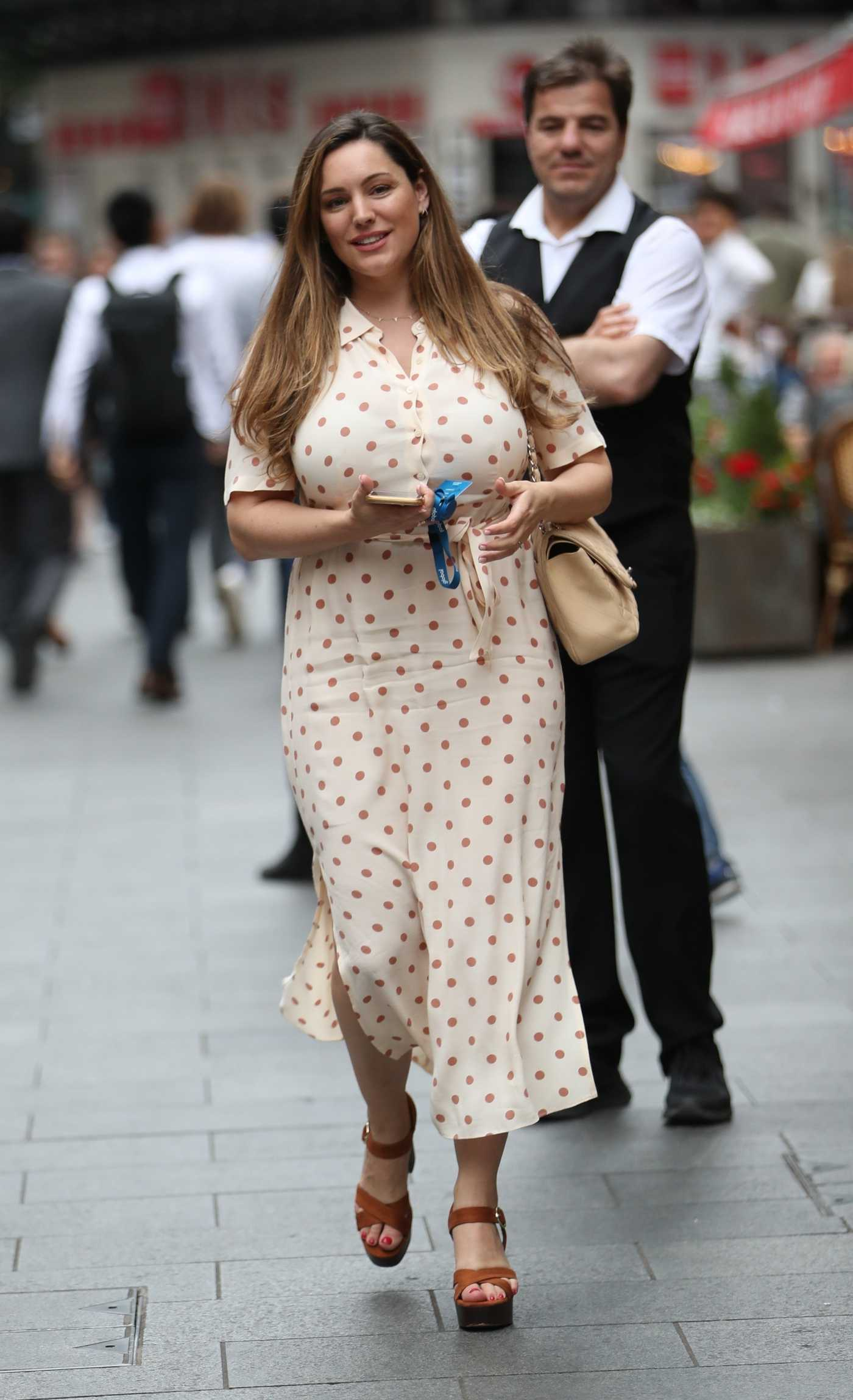 Kelly Brook in a Beige Polka Dot Dress Arrives at Global Radio Studios in London 07/09/2019