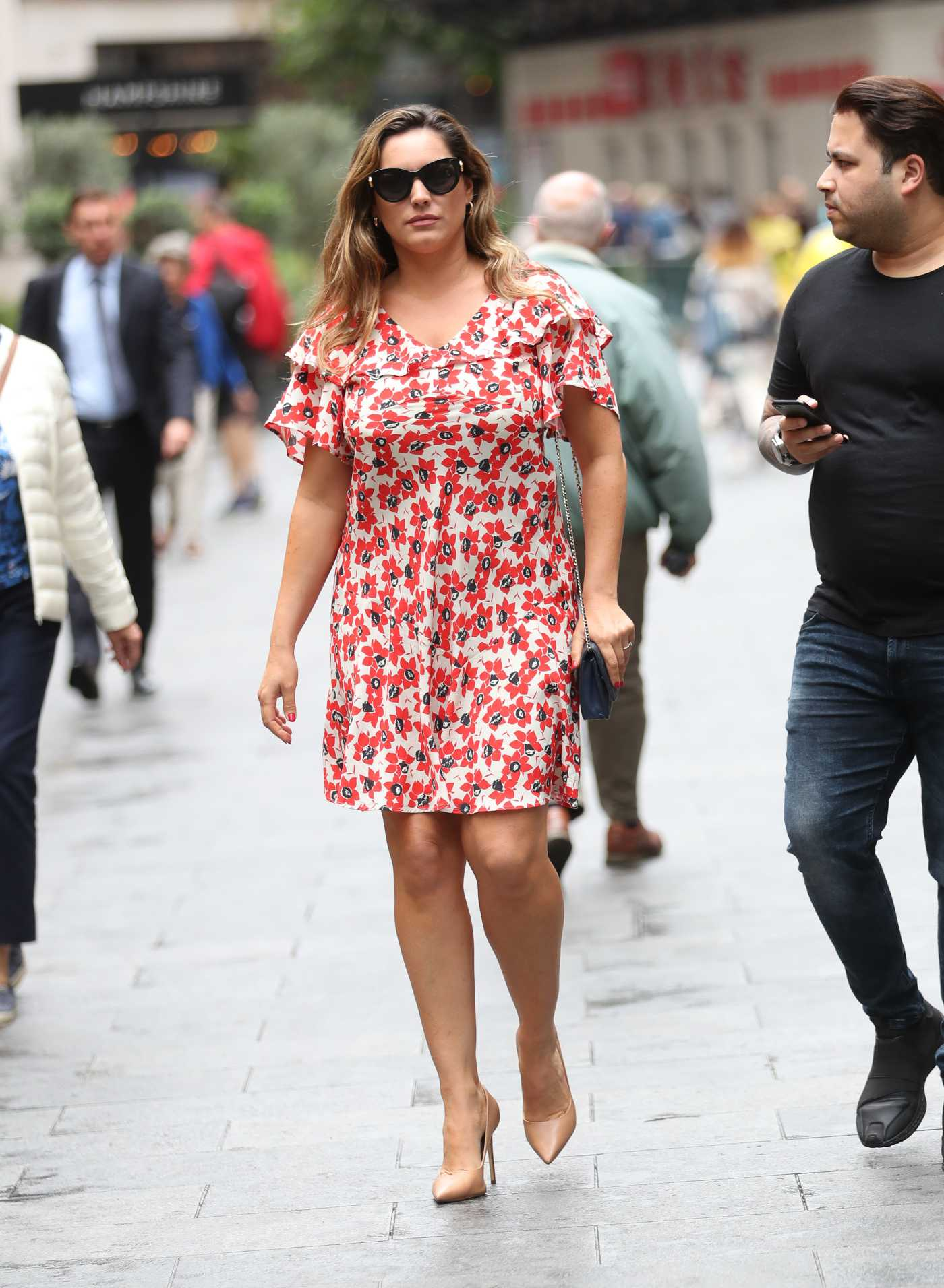 Kelly Brook in a Red Floral Dress Arrives at Global Radio Studios in London 07/18/2019