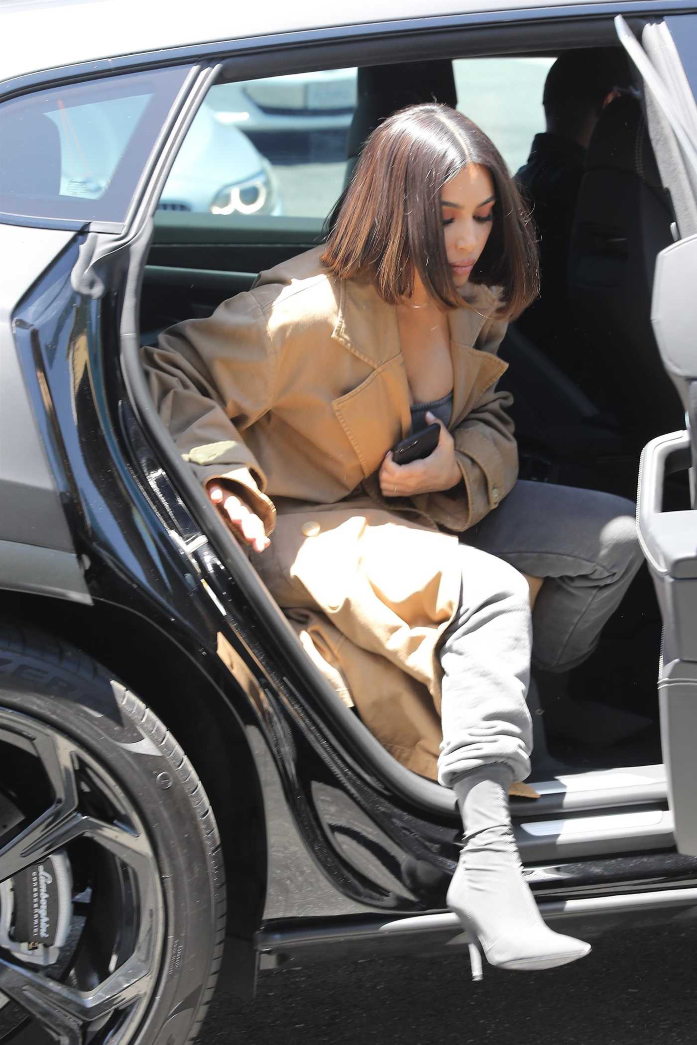 Kim Kardashian in a Beige Trench Coat Arrives to an Art Store in Los Angeles 07/10/2019
