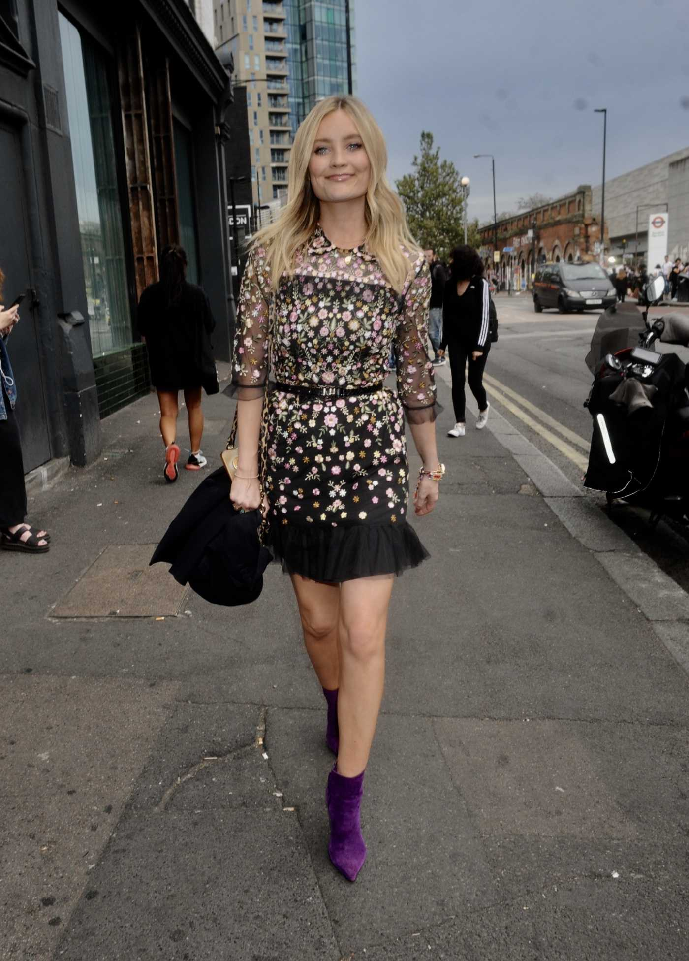 Laura Whitmore in a Floral Dress Arrives at the Warner Music Summer Party in London 07/17/2019