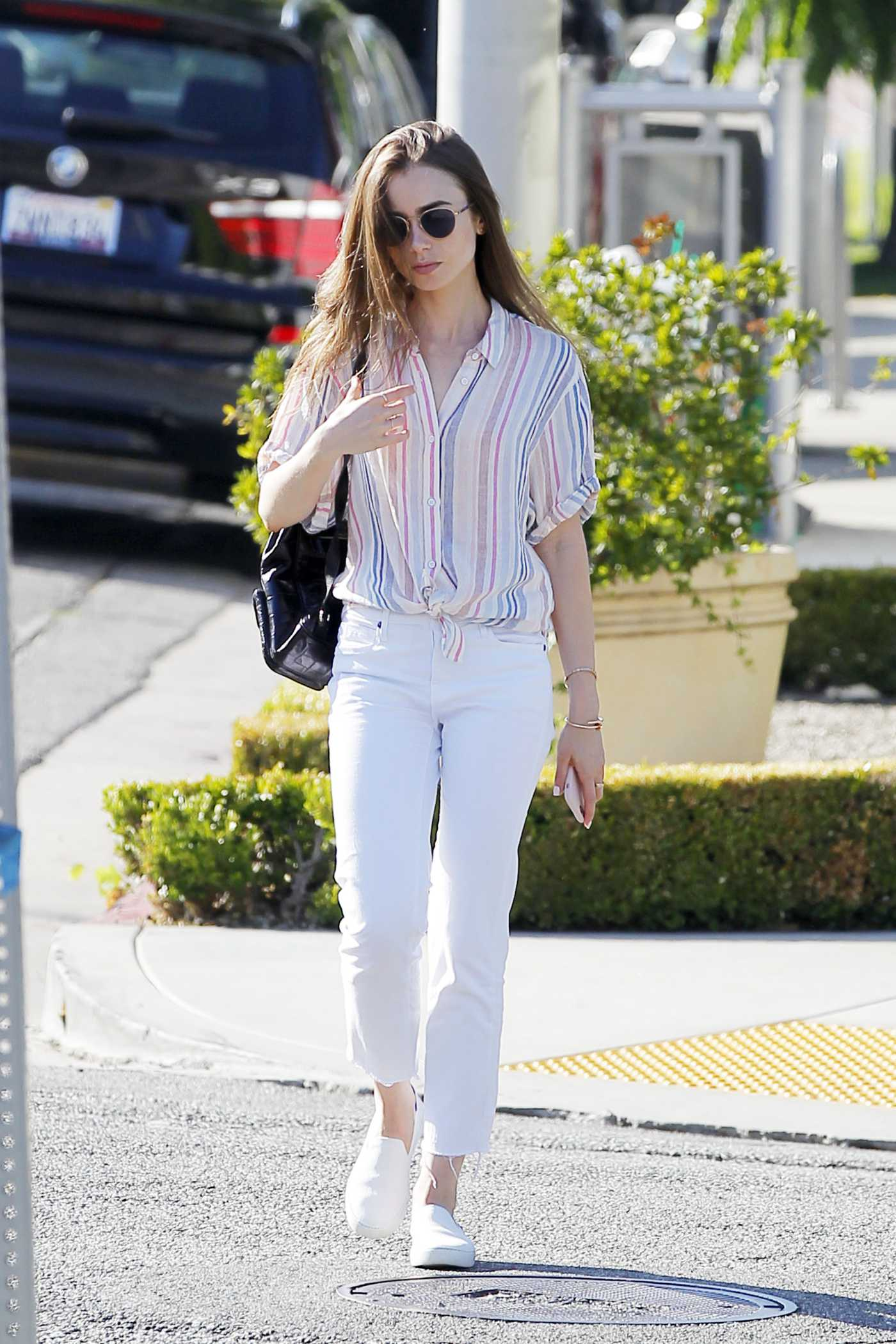 Lily Collins in a Striped Shirt Was Seen Out in Beverly Hills 07/17/2019