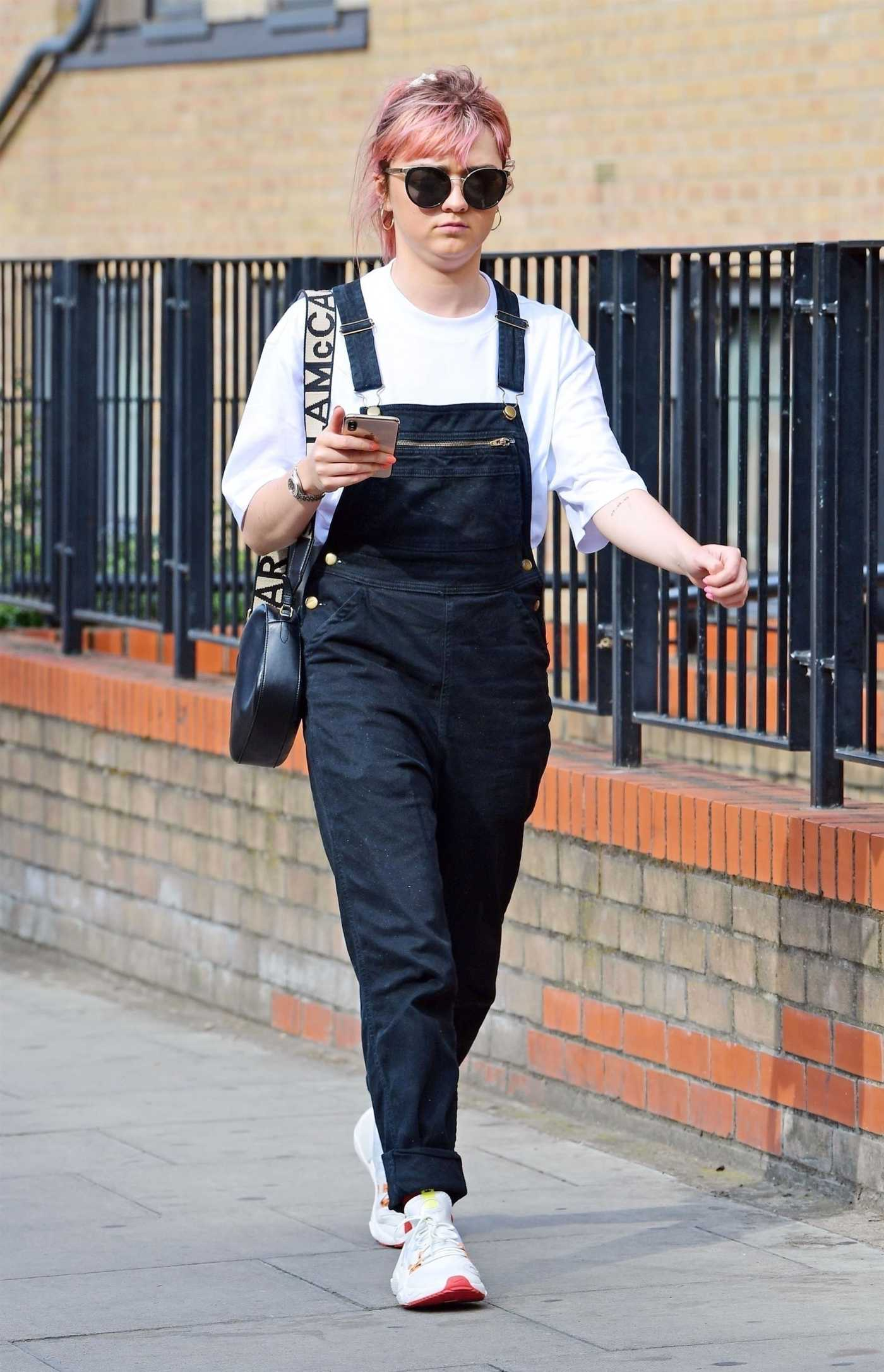 Maisie Williams in a Black Jumpsuit Was Seen Out in London 07/17/2019