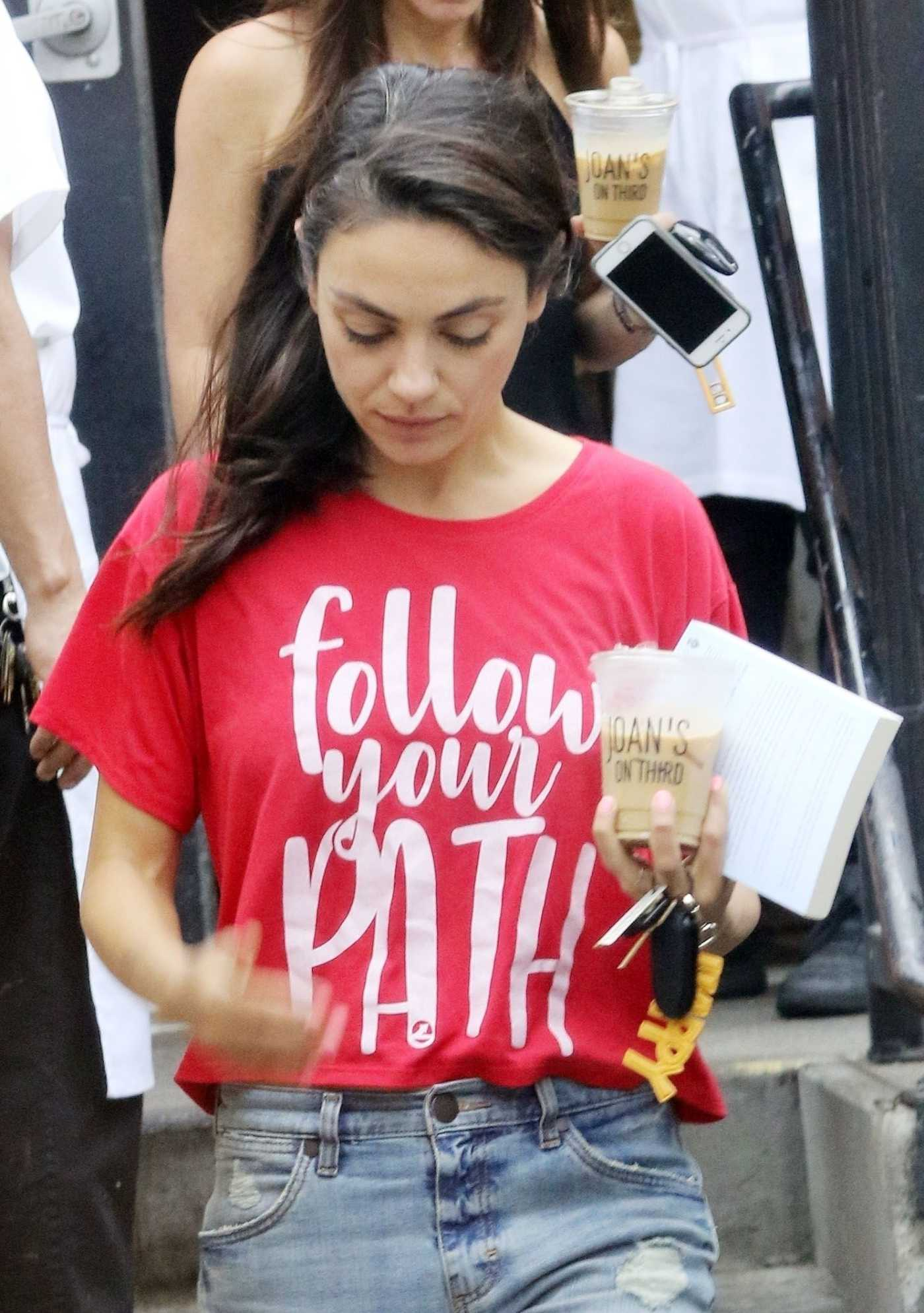 Mila Kunis in a Red Tee Heads Out of Joan's on Third with a Friend in Studio City 07/25/2019