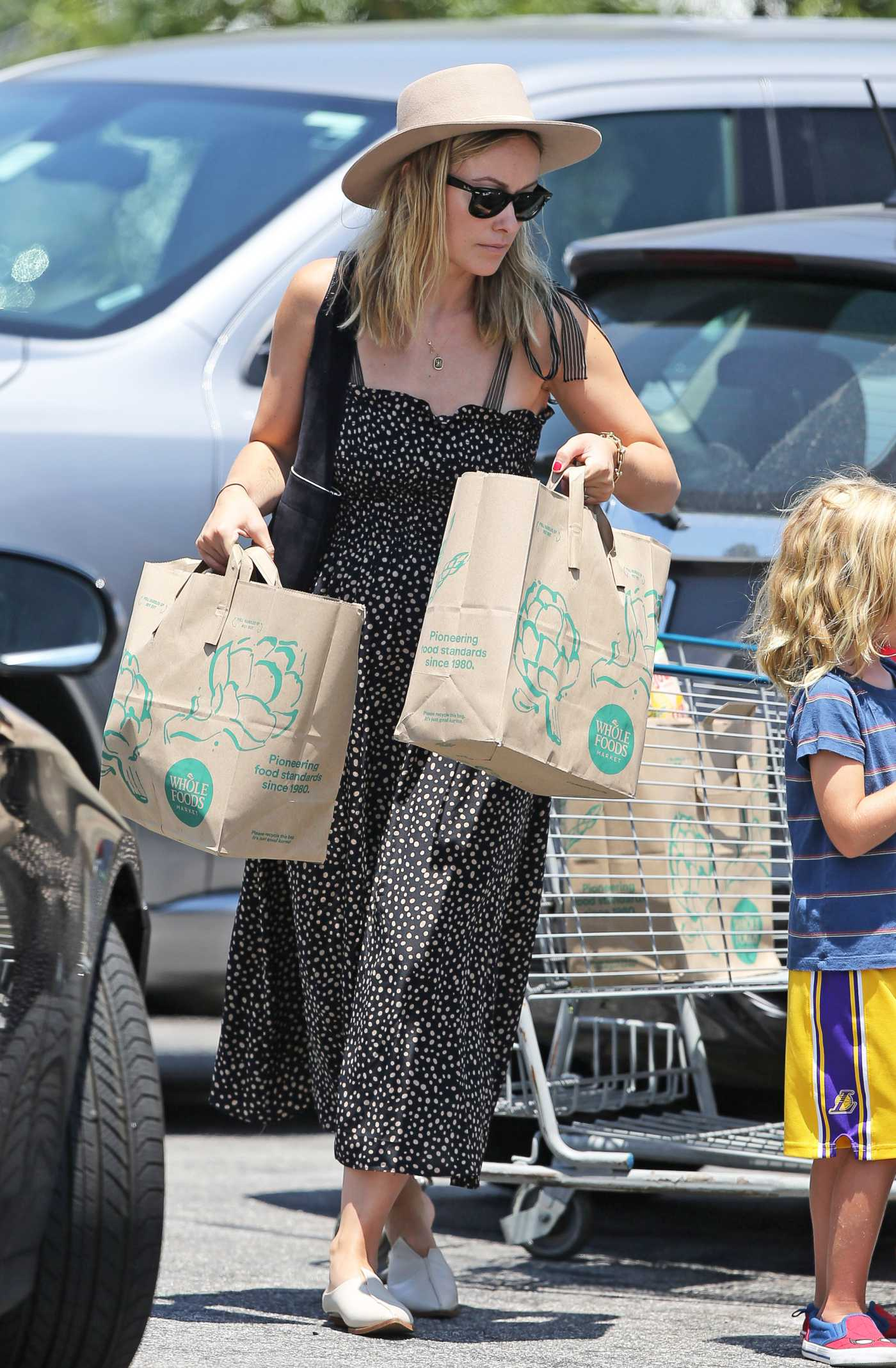 Olivia Wilde in a Beige Hat Shops at Whole Foods in Los Angeles 07/17/2019