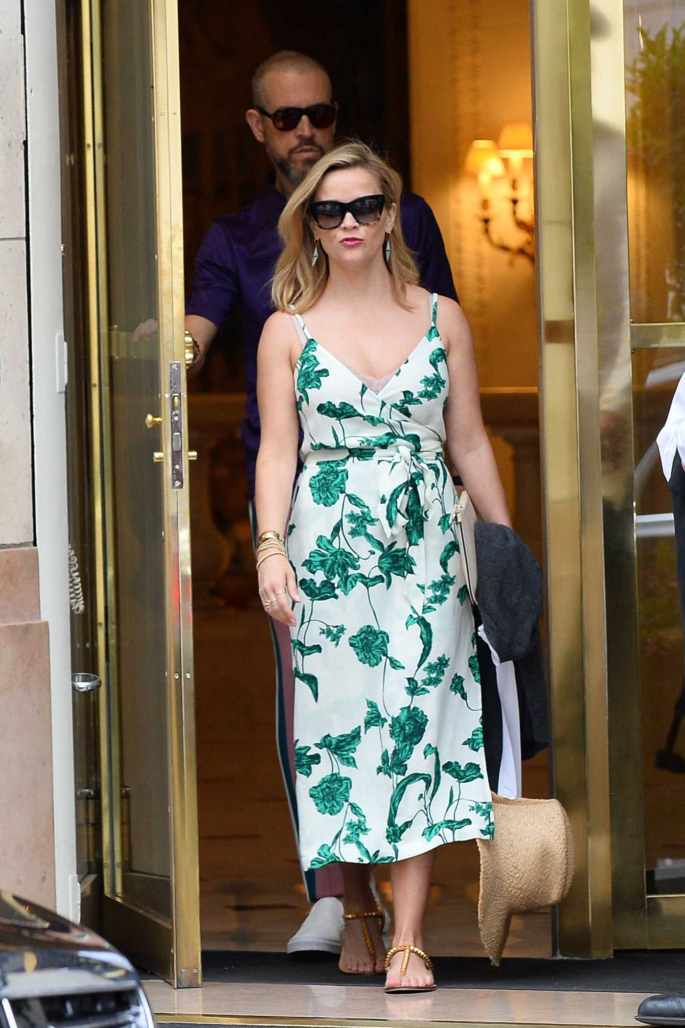 Reese Witherspoon in a White Floral Dress Leaves Bristol Hotel Out with Her Husband Jim Toth in Paris 06/30/2019