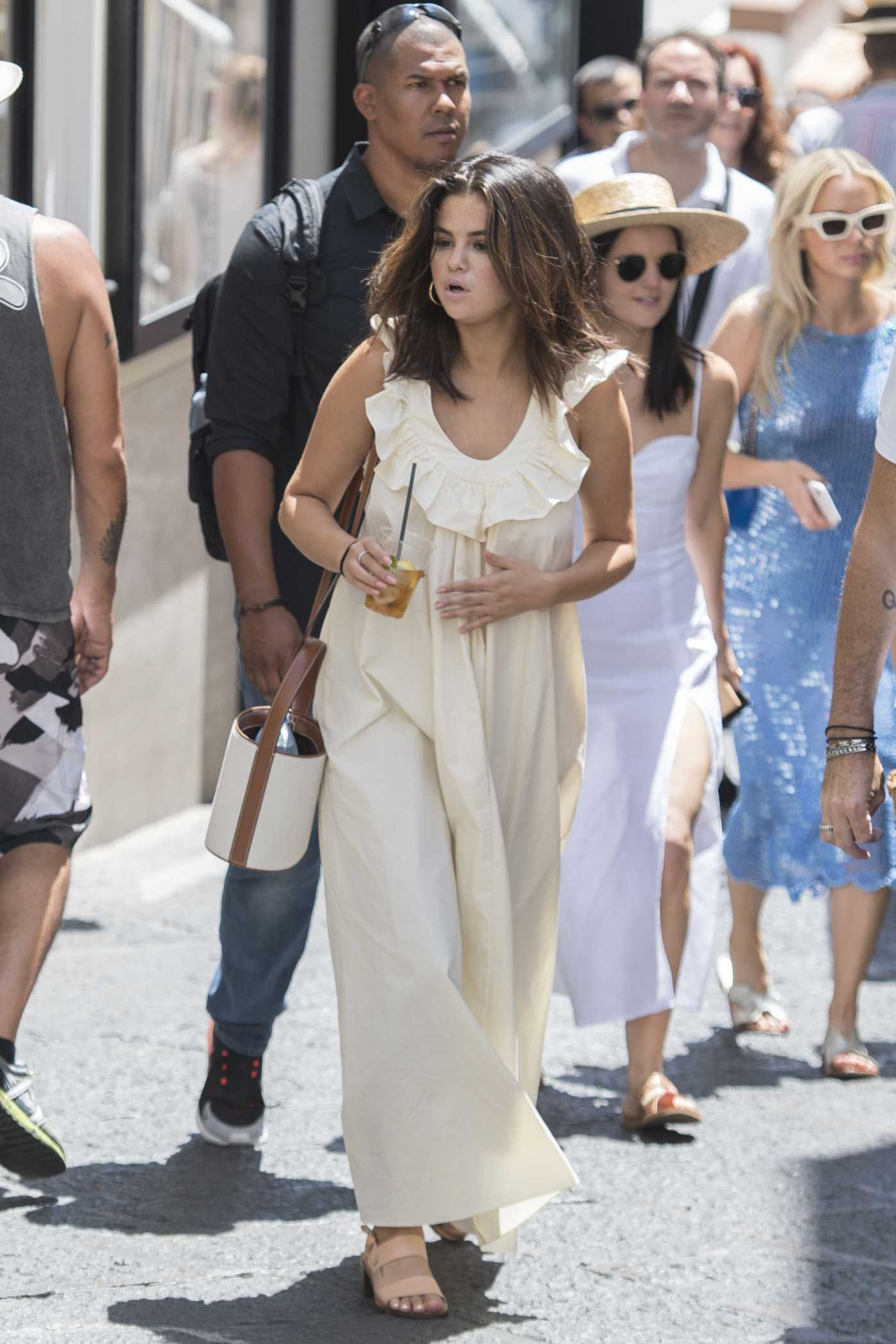 Selena Gomez in a Beige Sundress Was Seen Out with Her Friends in Capri 07/23/2019