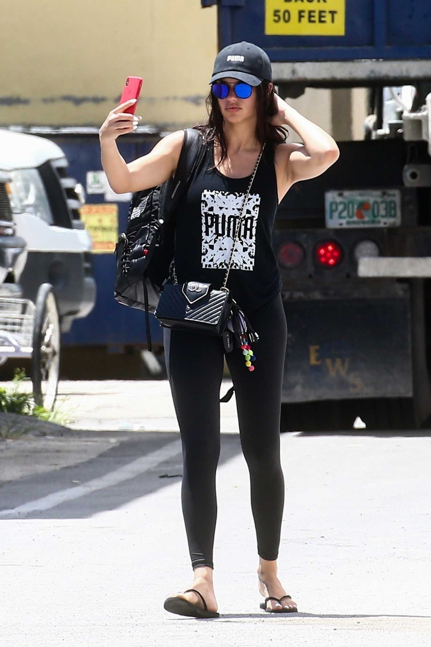 Adriana Lima in a Black Cap Was Seen Out in Miami 08/13/2019
