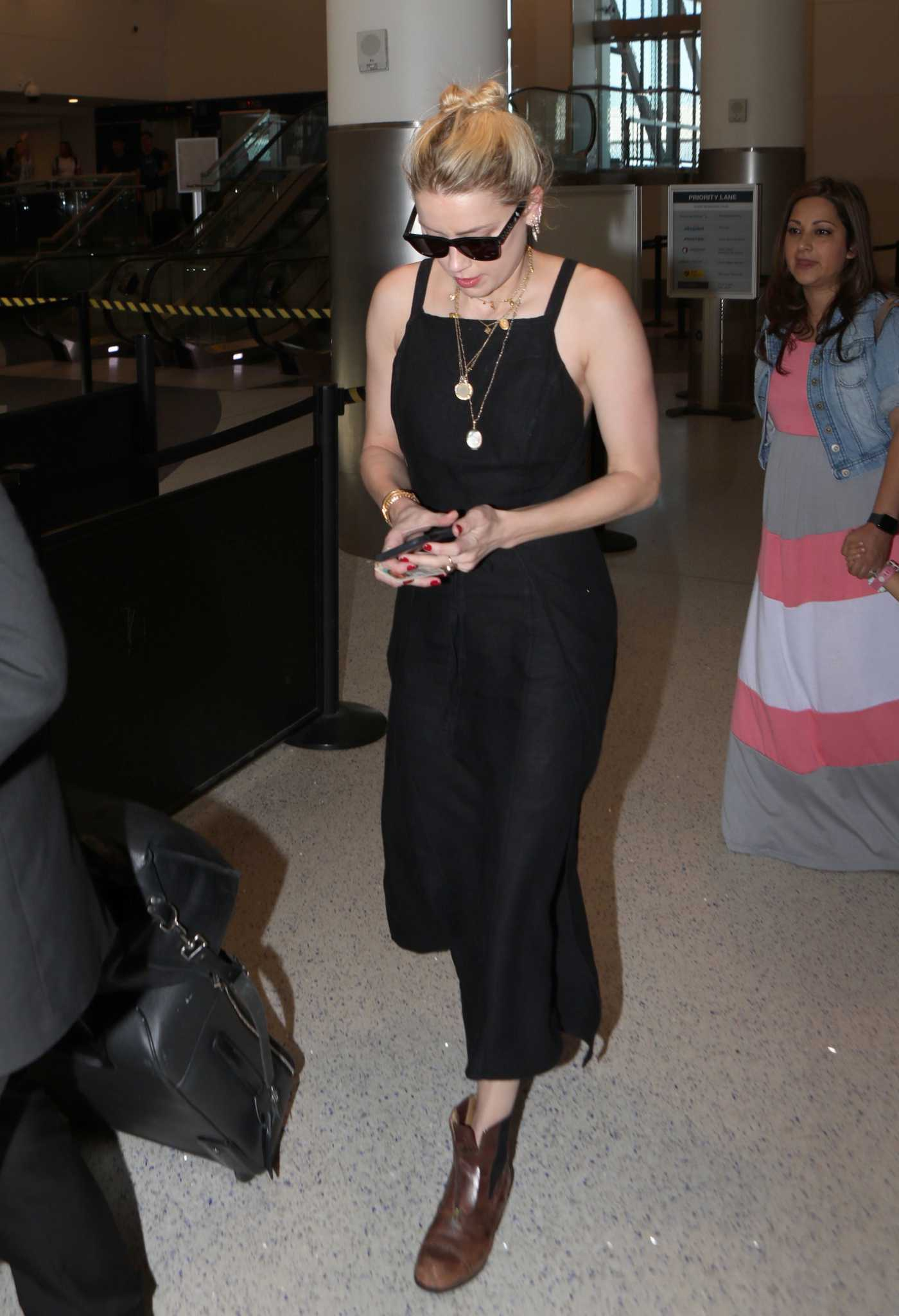 Amber Heard in a Black Dress Arrives at LAX Airport in Los Angeles 08/15/2019