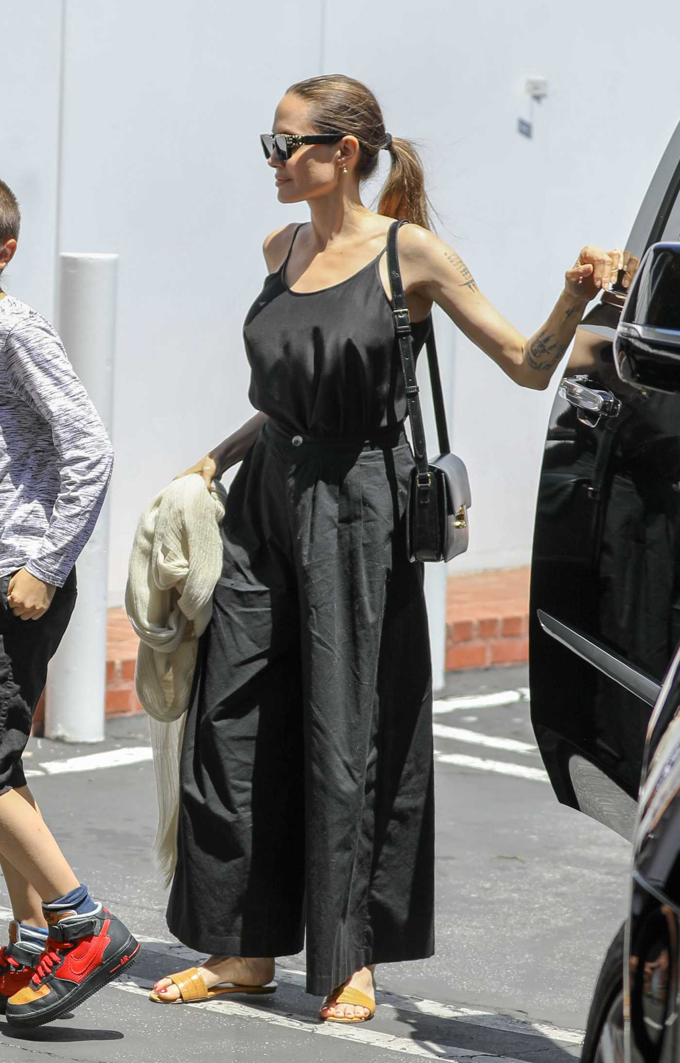Angelina Jolie in a Black Pants Was Seen Out with Her Daughter Vivenne in West Hollywood 08/02/2019