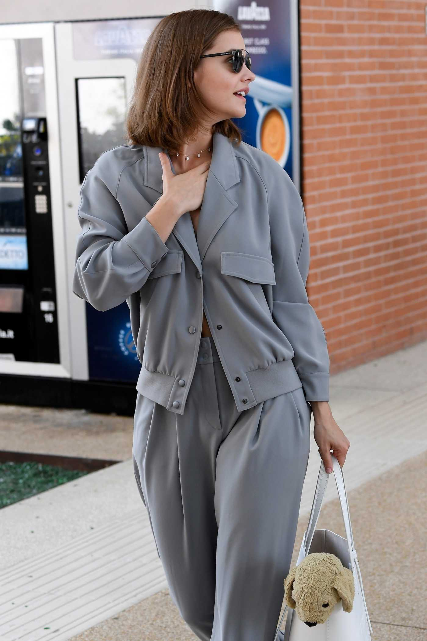 Barbara Palvin in a Gray Suit Arrives at the 76th Venice Film Festival in Italy 08/28/2019