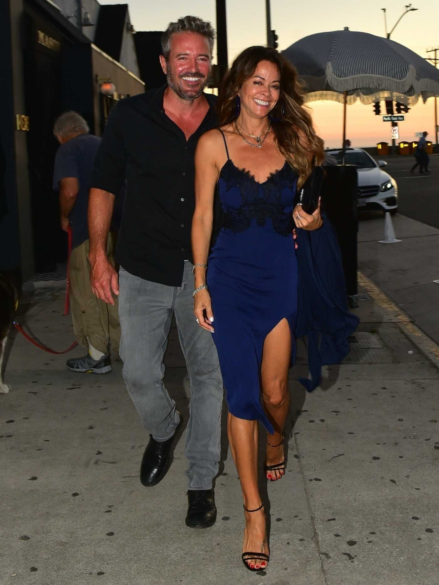 Brooke Burke in a Blue Dress Arrives at Giorgio Baldi Italian Restaurant in Santa Monica 08/20/2019