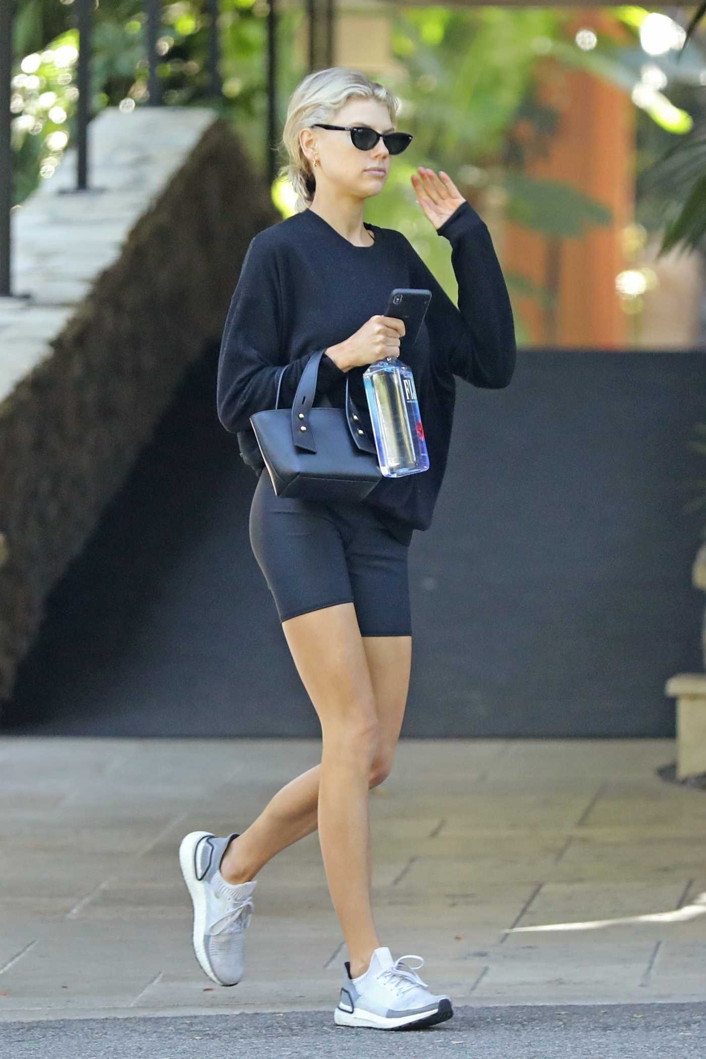 Charlotte McKinney in a Black Spandex Shorts Arrives at the Bel-Air Hotel in Beverly Hills 08/24/2019