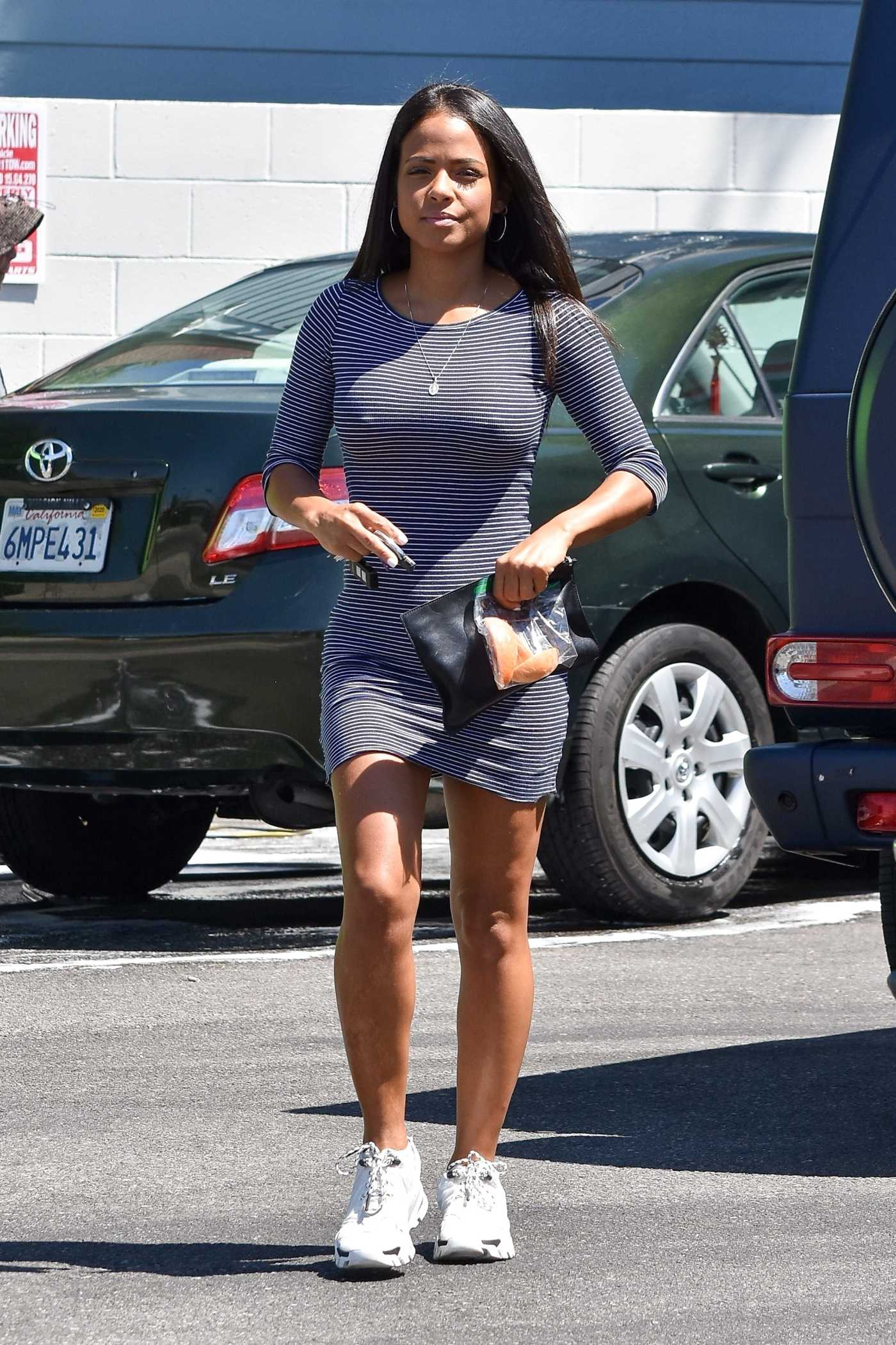 Christina Milian in a White Sneakers Arrives at 7-Eleven Store in Los Angeles 08/02/2019