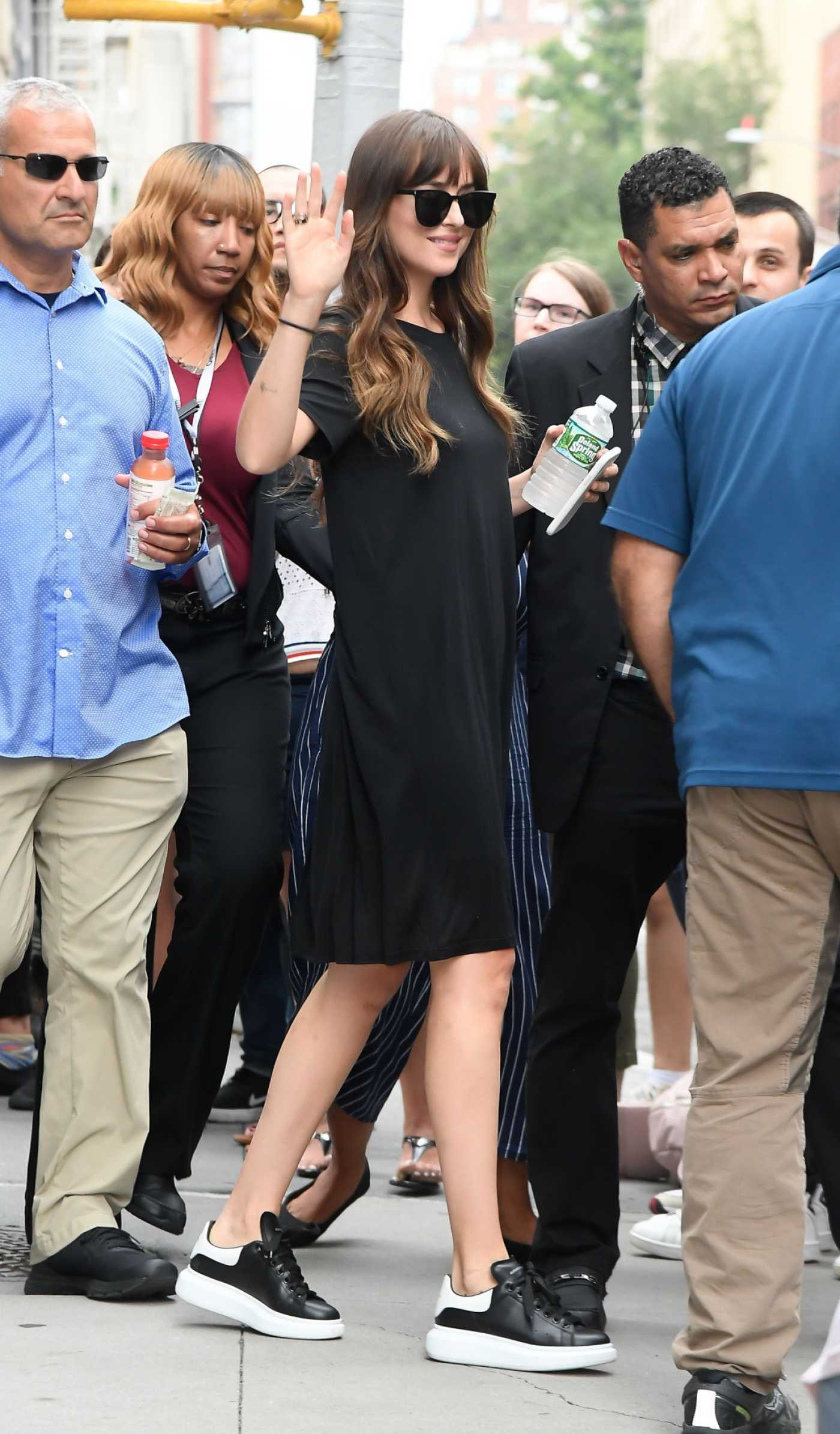 Dakota Johnson in a Black Dress Leaves AOL Build Studios in New York City 08/07/2019