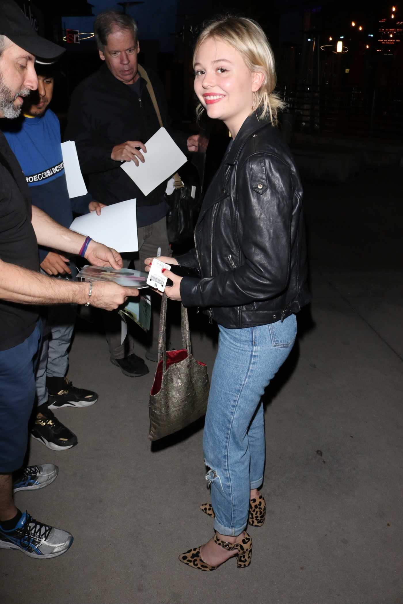 Emily Alyn Lind in a Black Leather Jacket Leaves the Low Low Premiere at ArcLight Theatre in Hollywood 08/15/2019