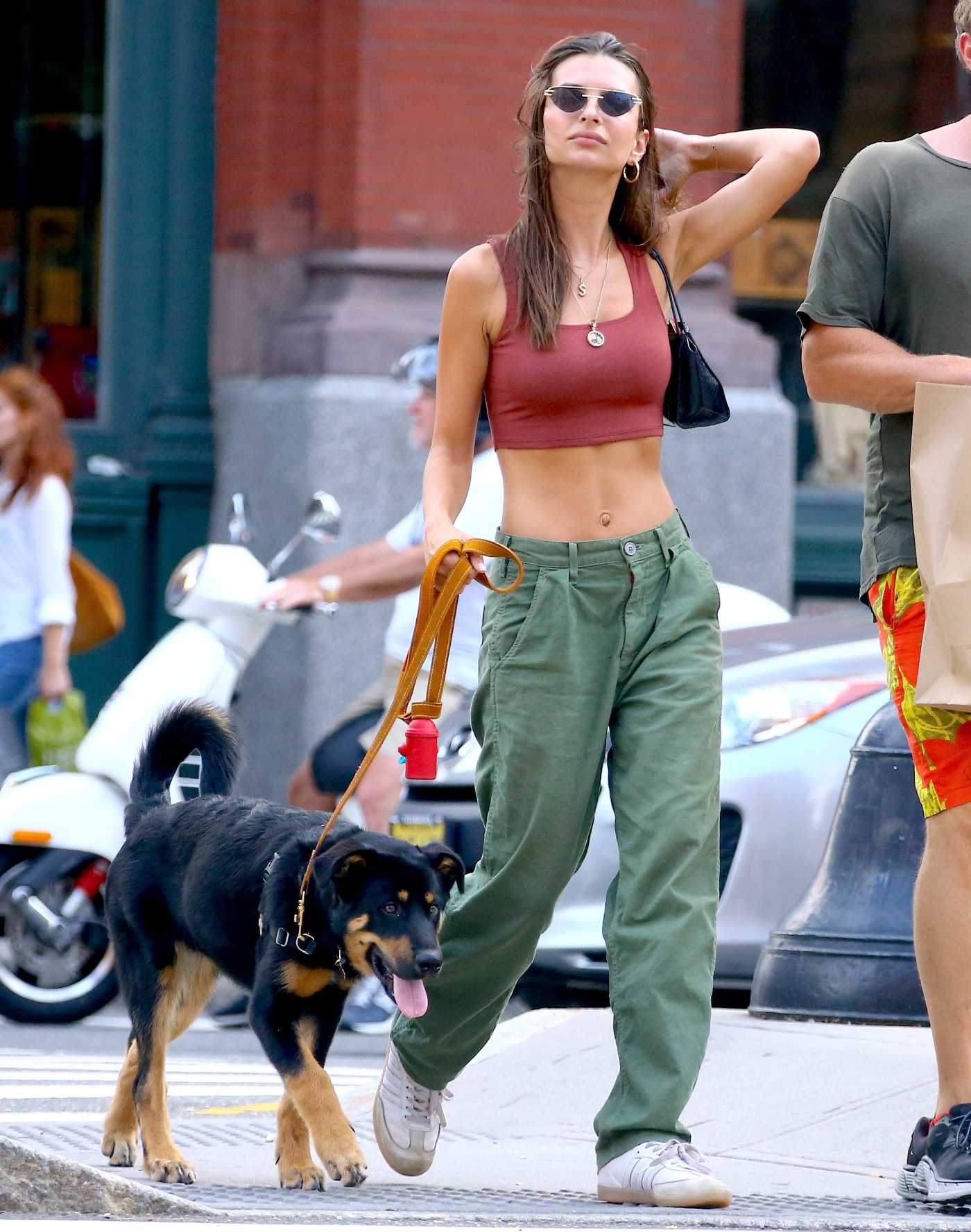 Emily Ratajkowski in a Green Pants Walks Her Dog Out with Sebastian Bear-McClard in New York City 08/17/2019