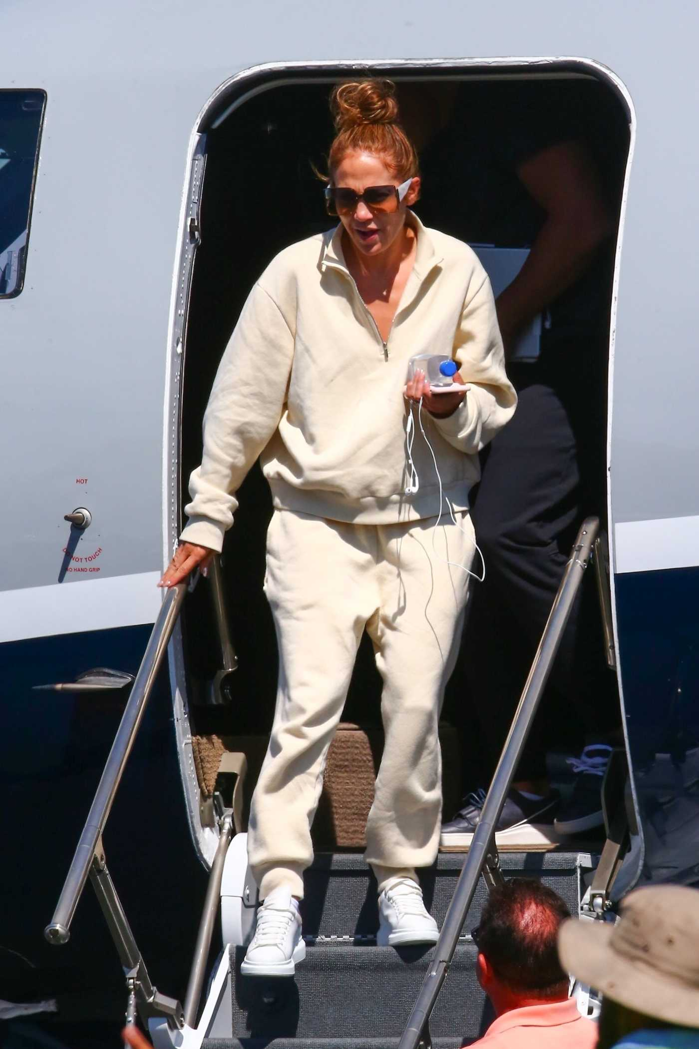Jennifer Lopez in a Beige Jogging Suit Leaves Her Private Jet in Los Angeles 08/23/2019
