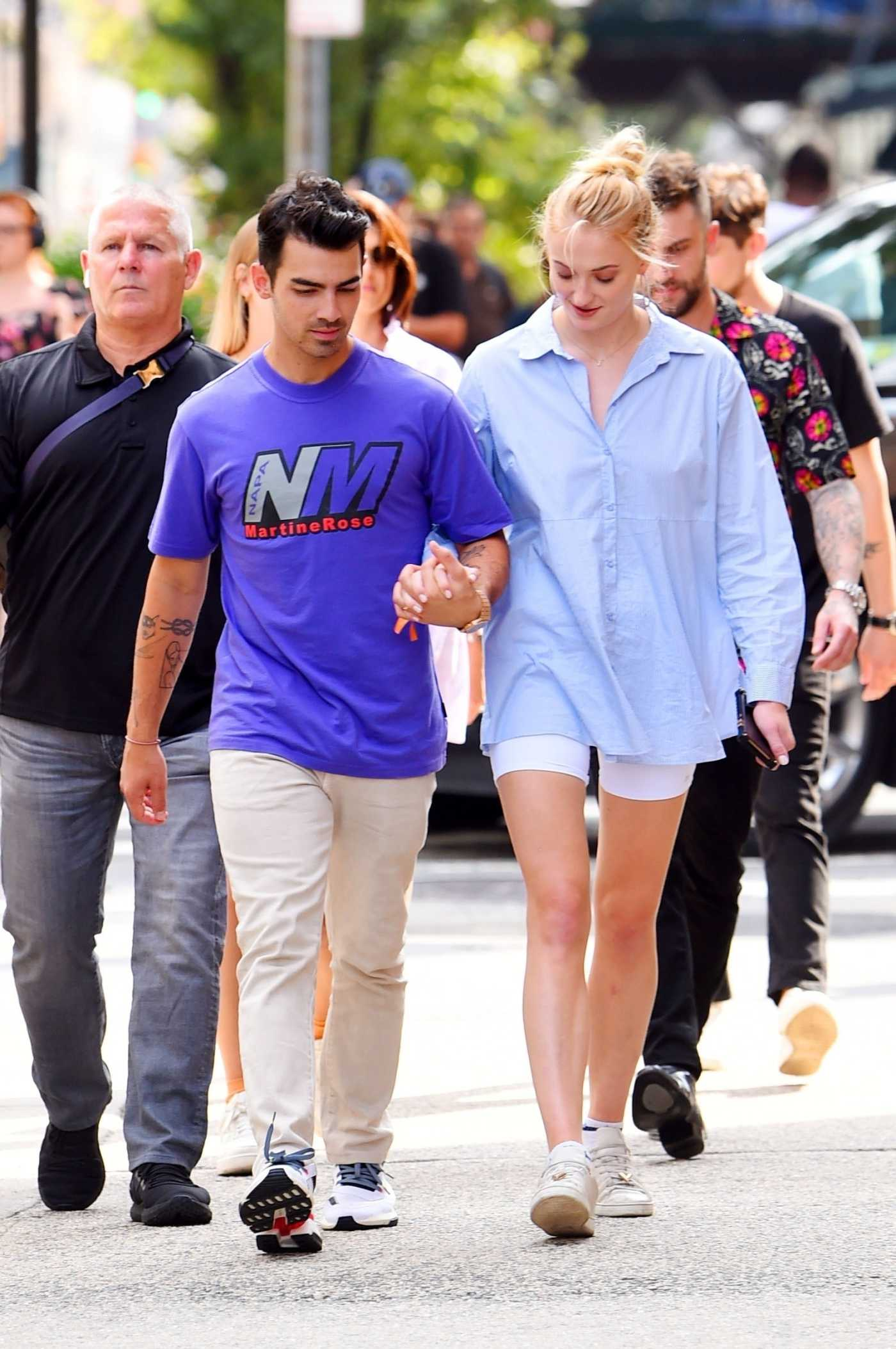 Joe Jonas in a Beige Pants Was Seen Out with Sophie Turner in New York 08/16/2019