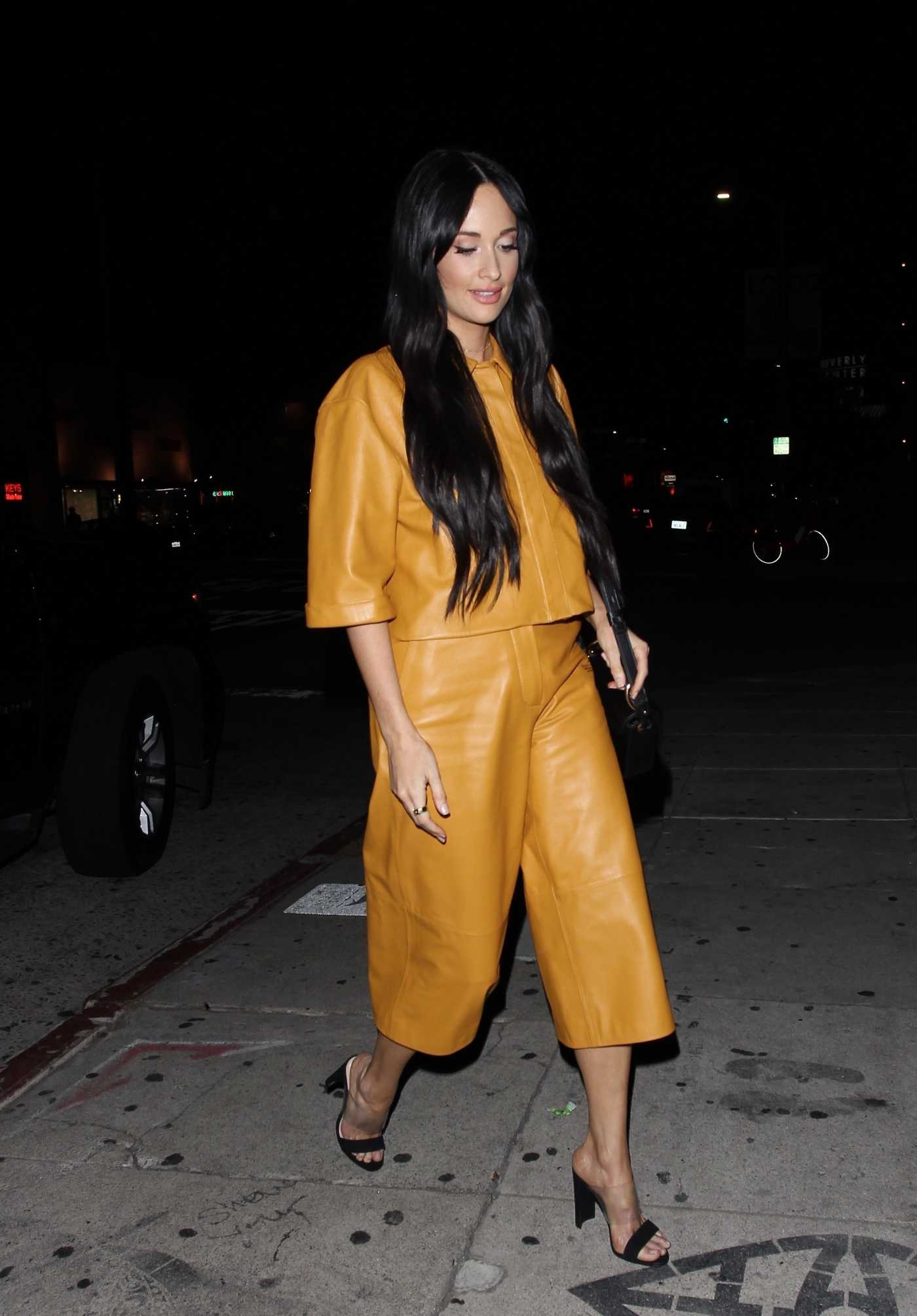 Kacey Musgraves in a Yellow Leather Suit Arrives at the Nice Guy Club in West Hollywood 08/23/2019
