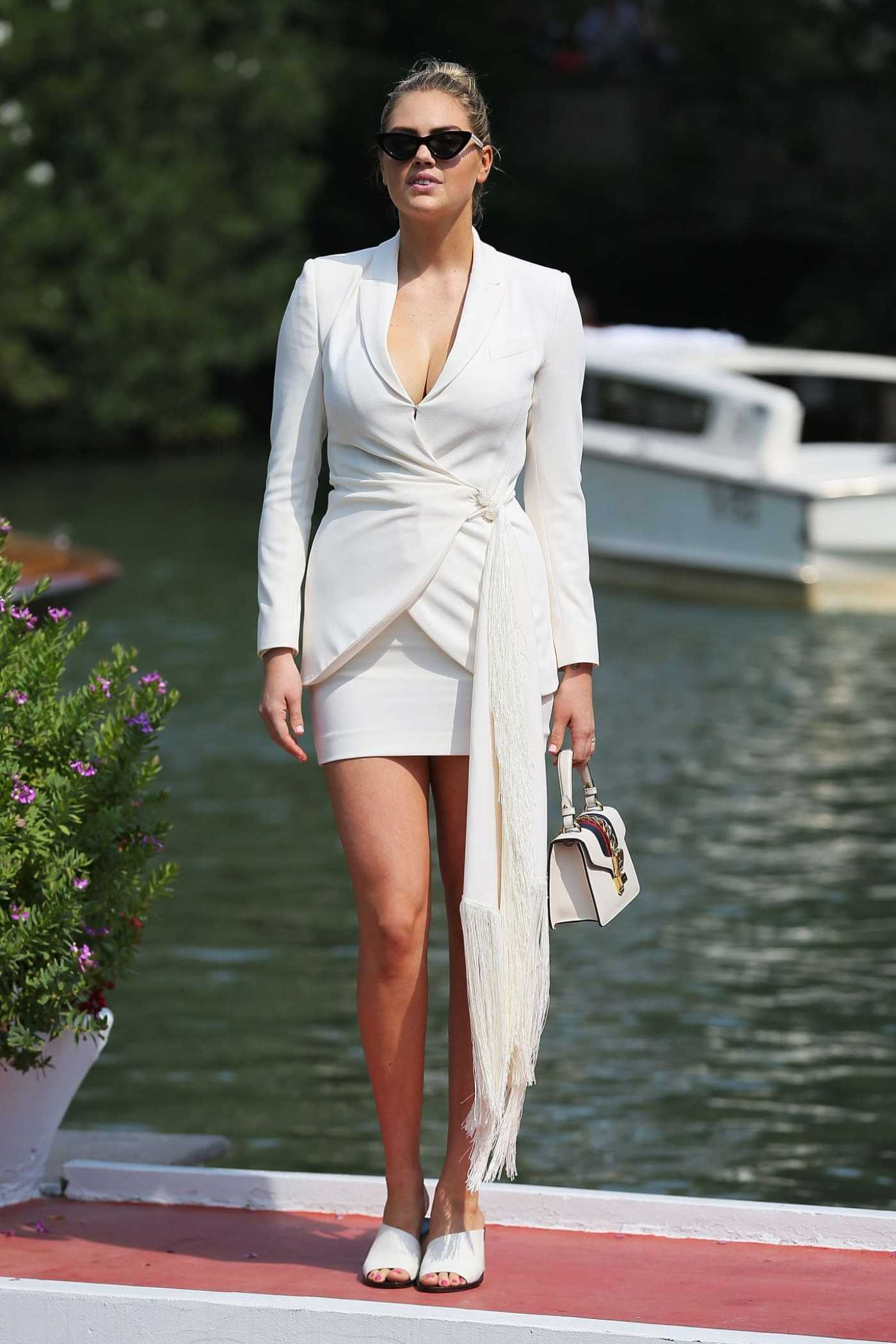 Kate Upton in a White Suit Arrives at the 76th Venice Film Festival in Venice 08/29/2019