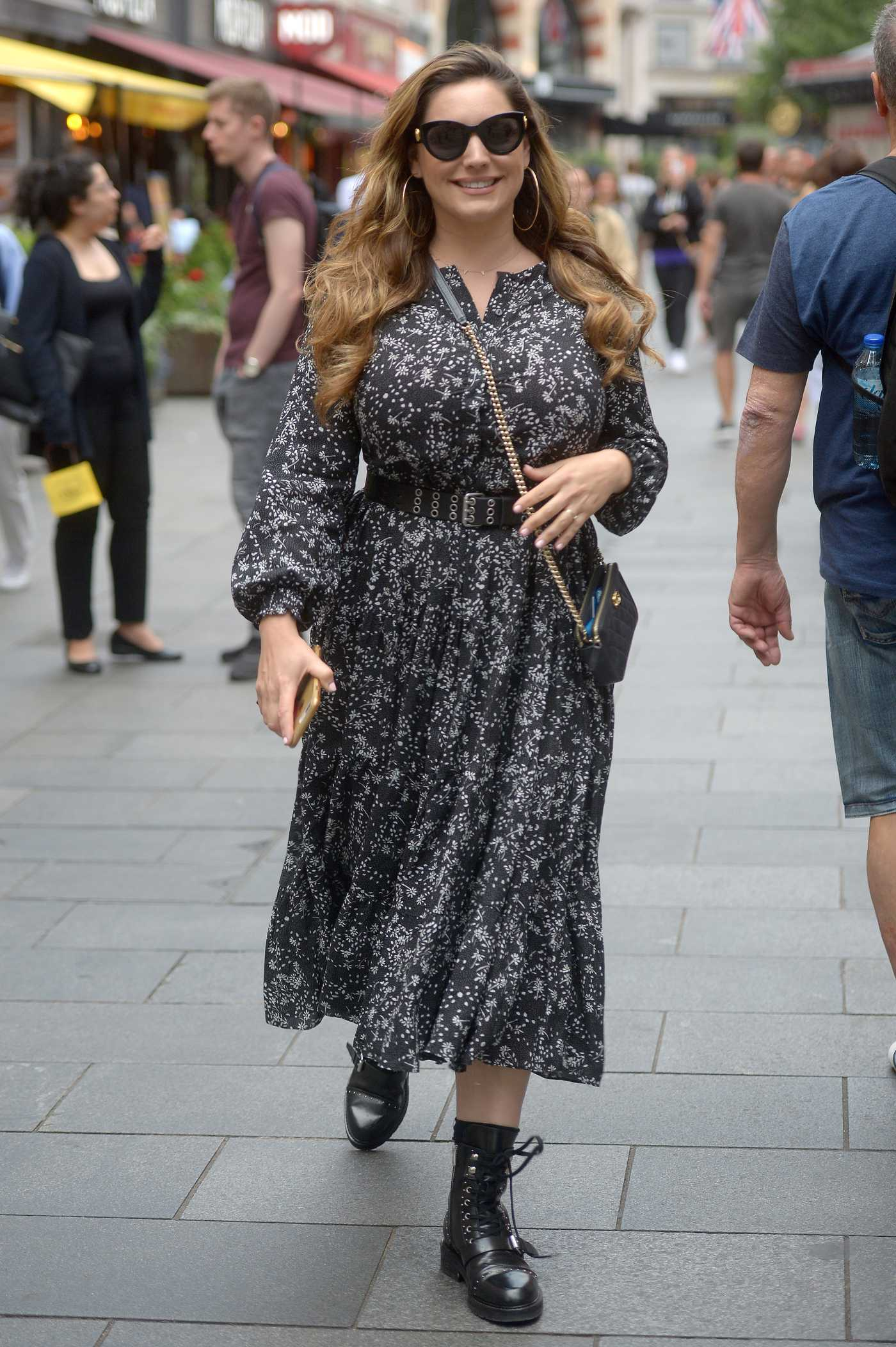 Kelly Brook in a Black Floral Dress Arrives at Global Radio Studios in London 08/05/2019