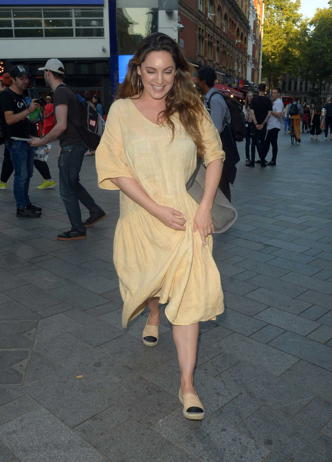 Kelly Brook in a Yellow Dress Arrives at Global Radio Studios in London 08/23/2019