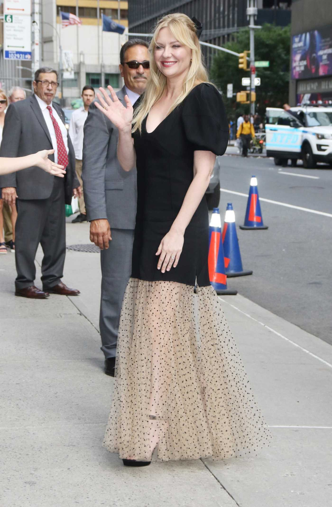 Kirsten Dunst in a Black Blouse Arrives at The Late Show with Stephen Colbert in New York 08/15/2019