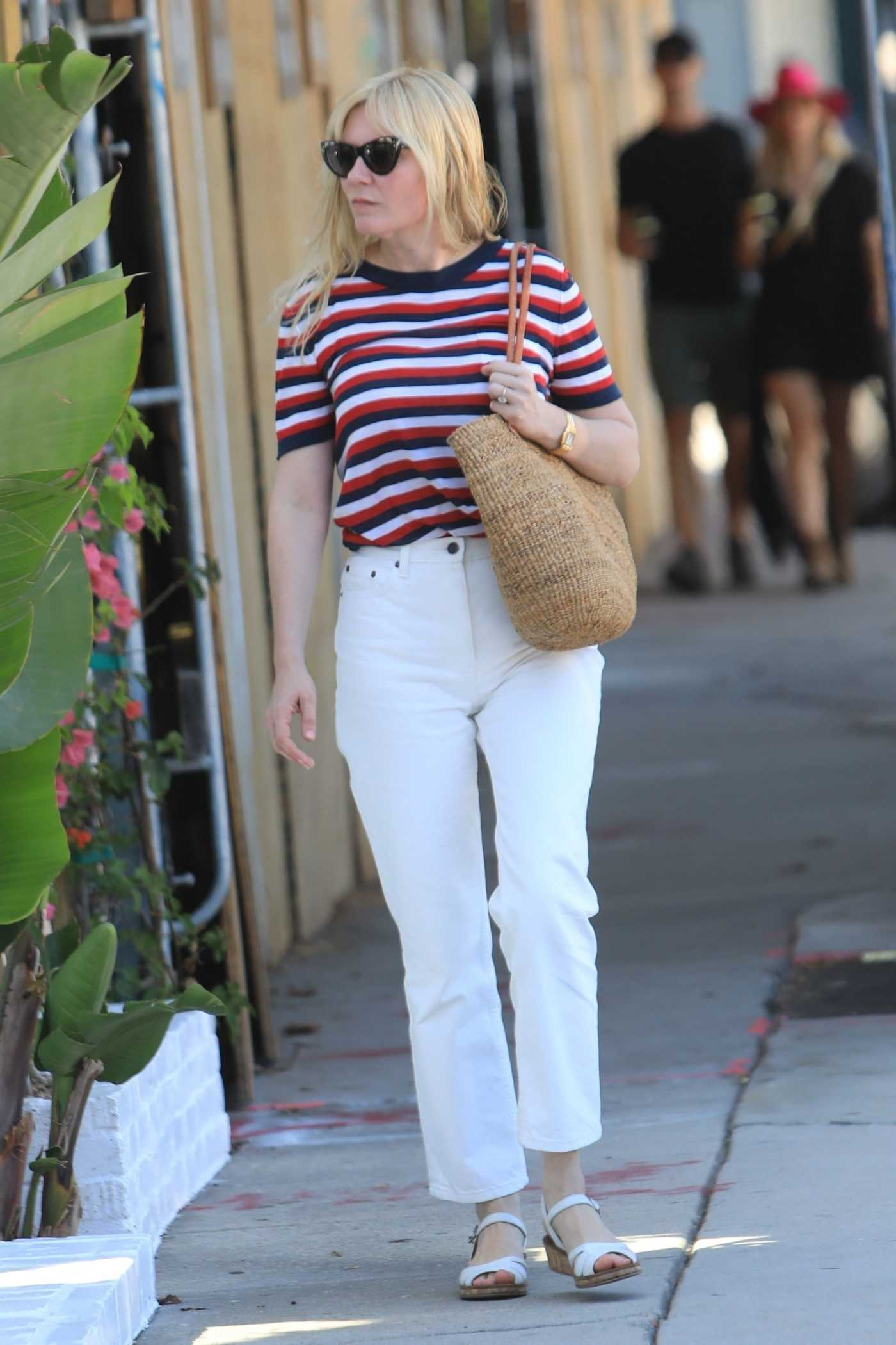 Kirsten Dunst in a Striped Tee Leaves the Hair Salon in West Hollywood 08/27/2019