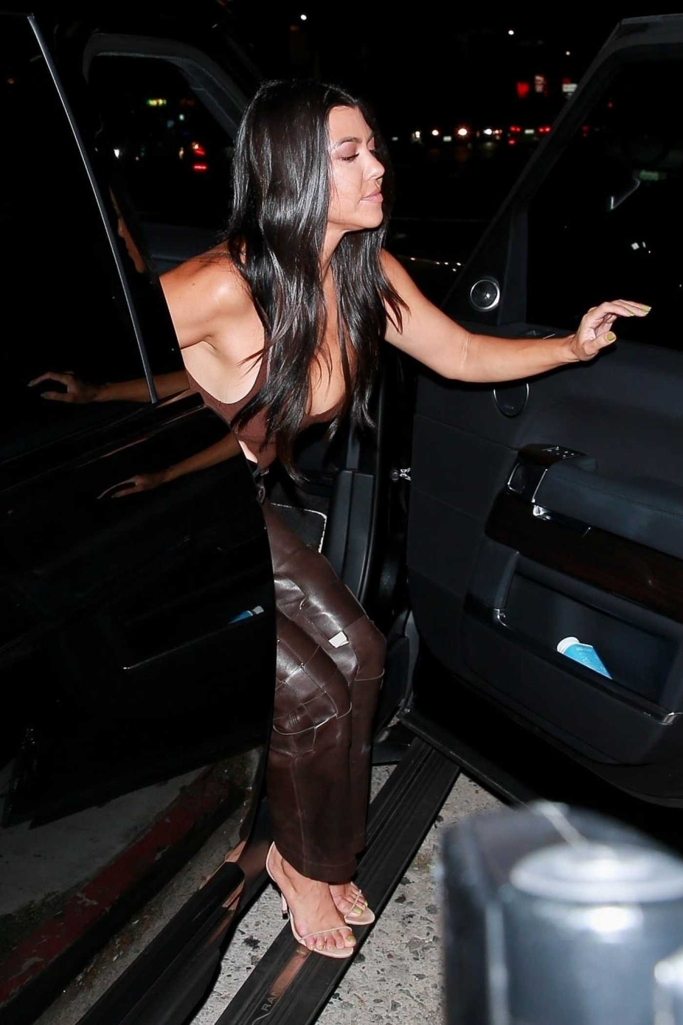 Kourtney Kardashian in a Brown Leather Pants Arrives at the Nice Guy in West Hollywood 08/23/2019