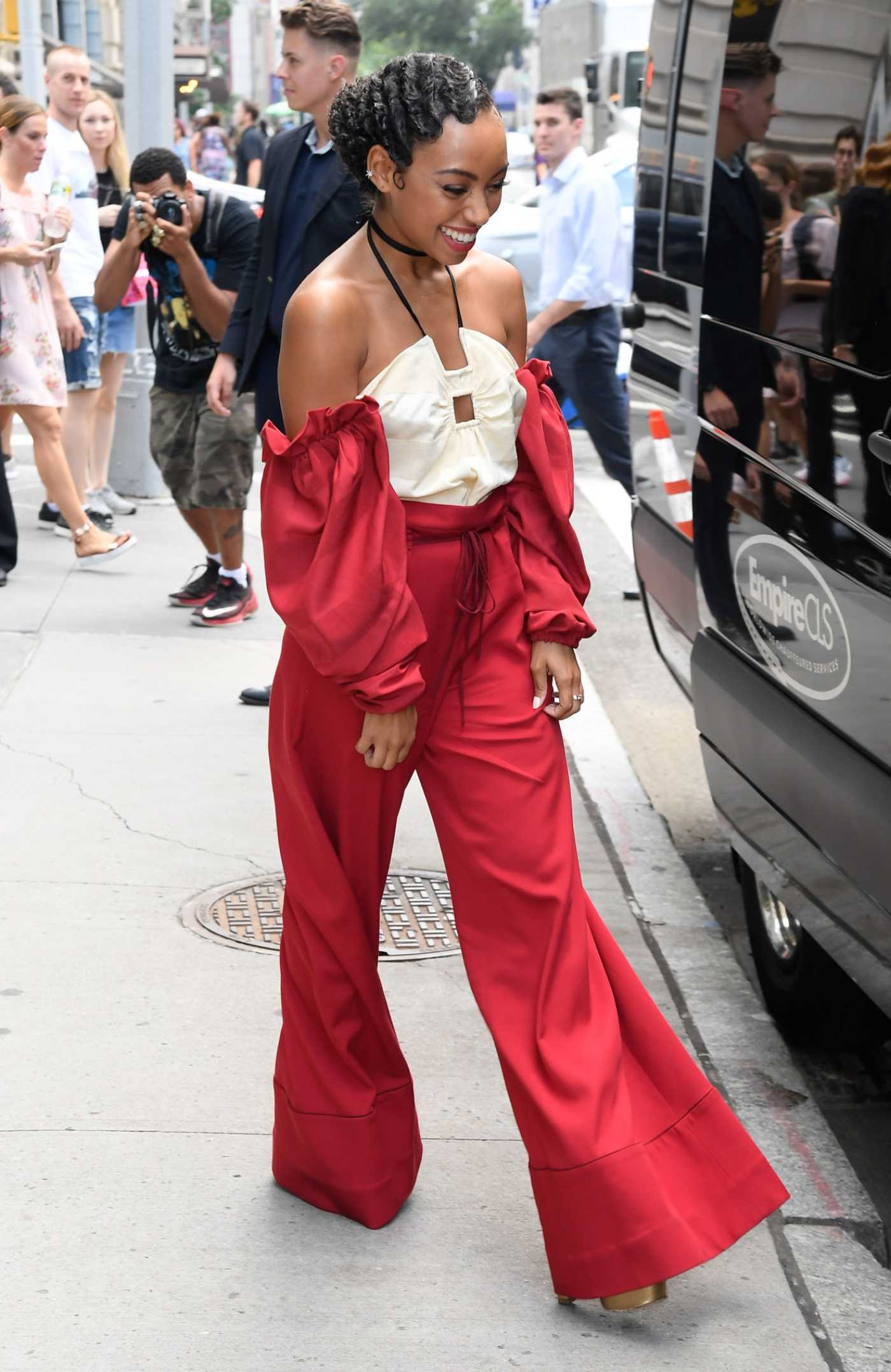 Logan Browning in a Red Pants Was Seen Out in New York City 07/31/2019