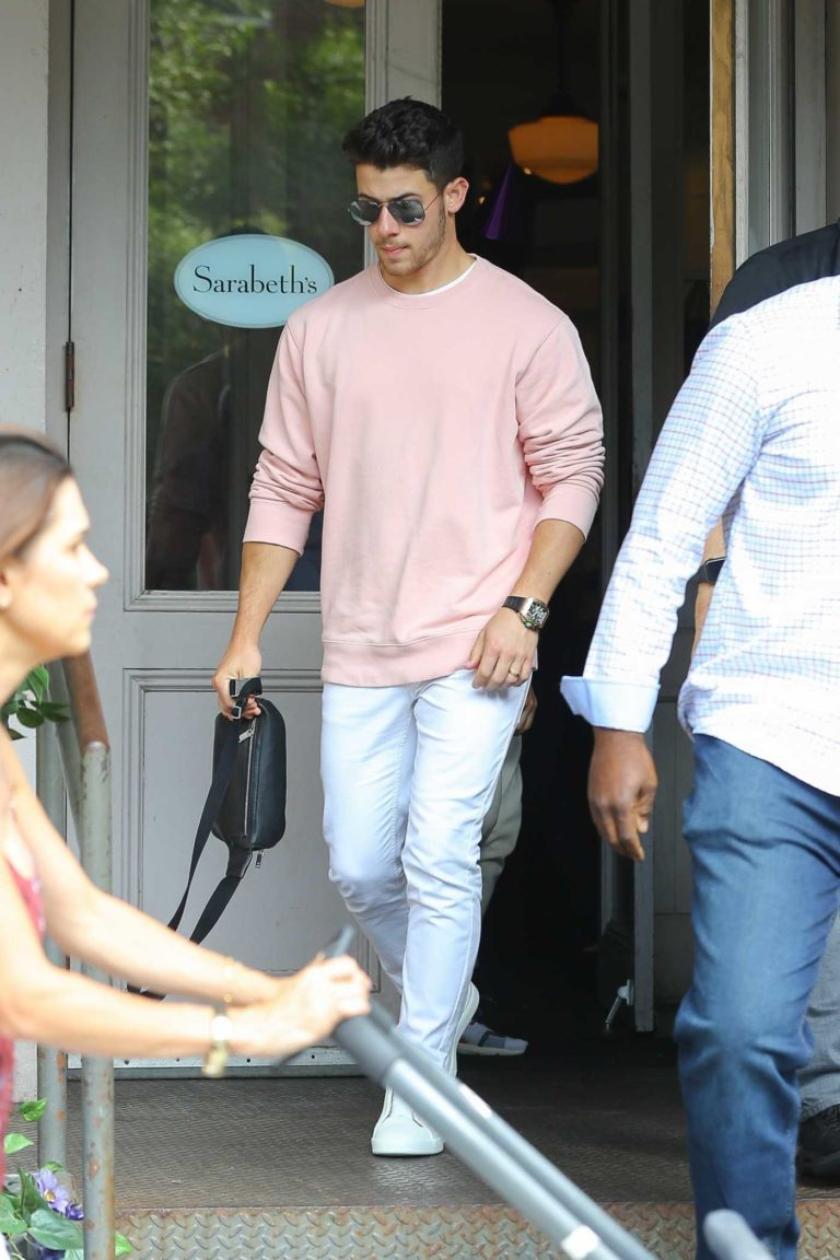 Nick Jonas in a Pink Sweatshirt