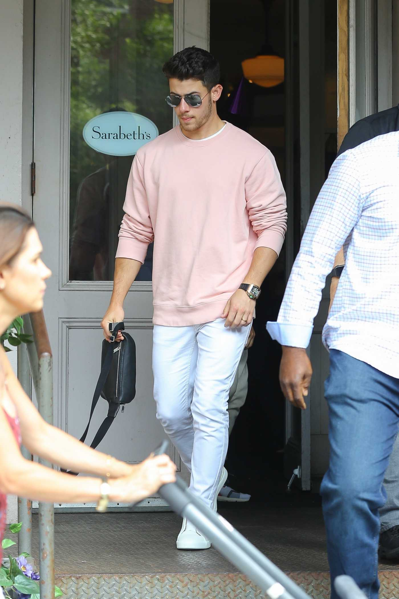 Nick Jonas in a Pink Sweatshirt Was Seen Out in New York 08/16/2019
