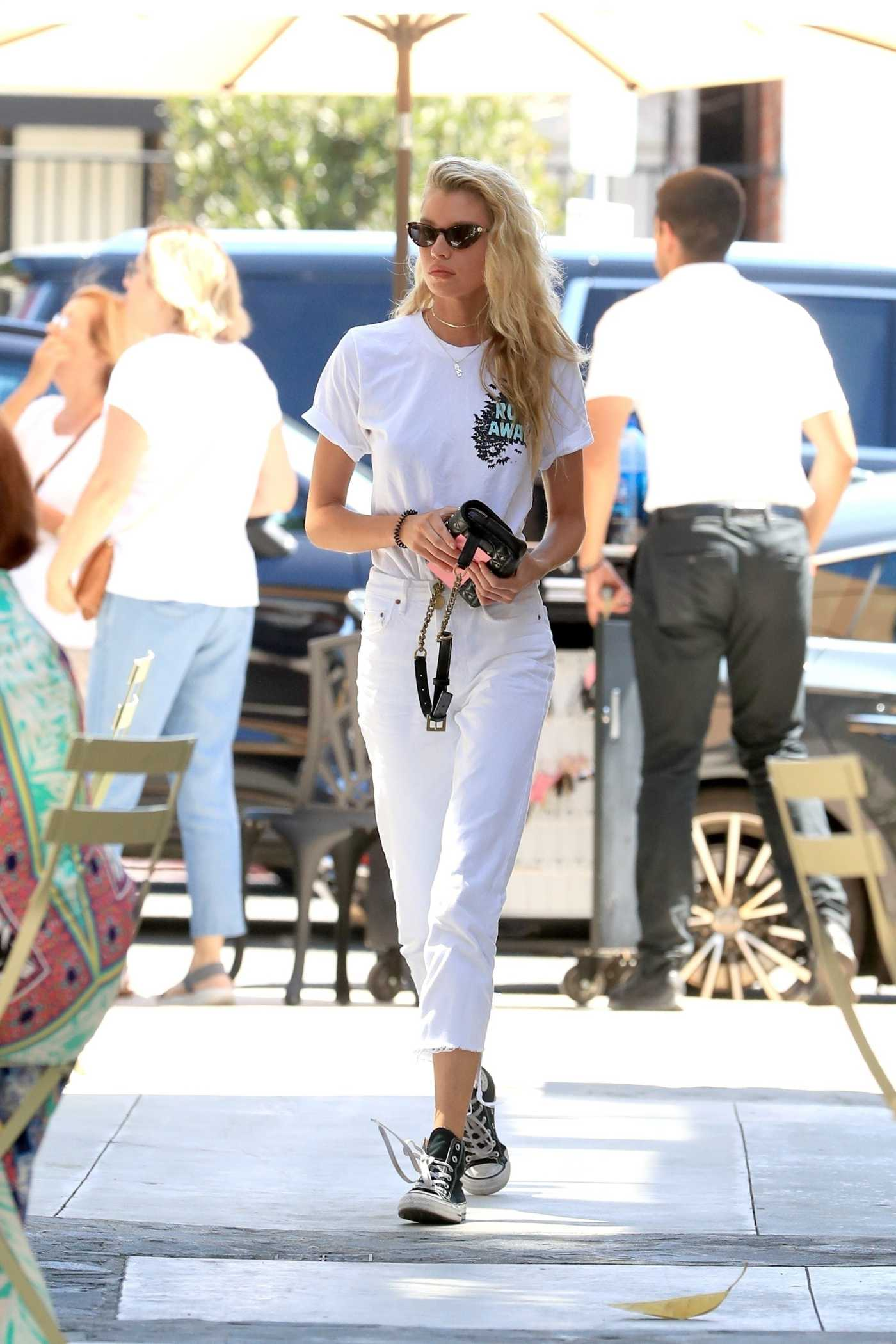 Stella Maxwell in a White Tee Arrives at celeb salon Nine Zero One in West Hollywood 08/02/2019