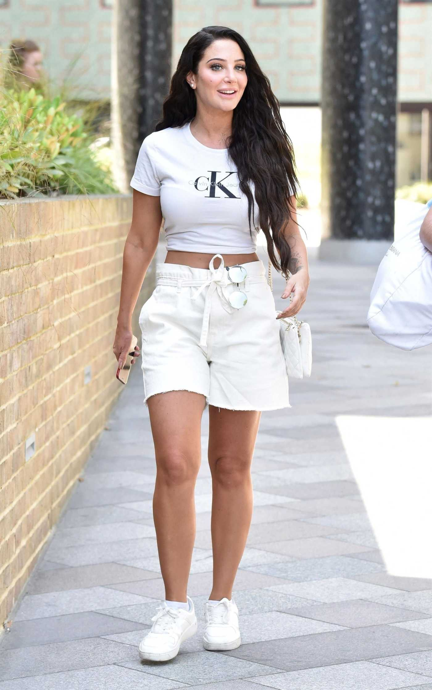 Tulisa Contostavlos in a White Tee Arrives at ITV Studios in London 07/23/2019