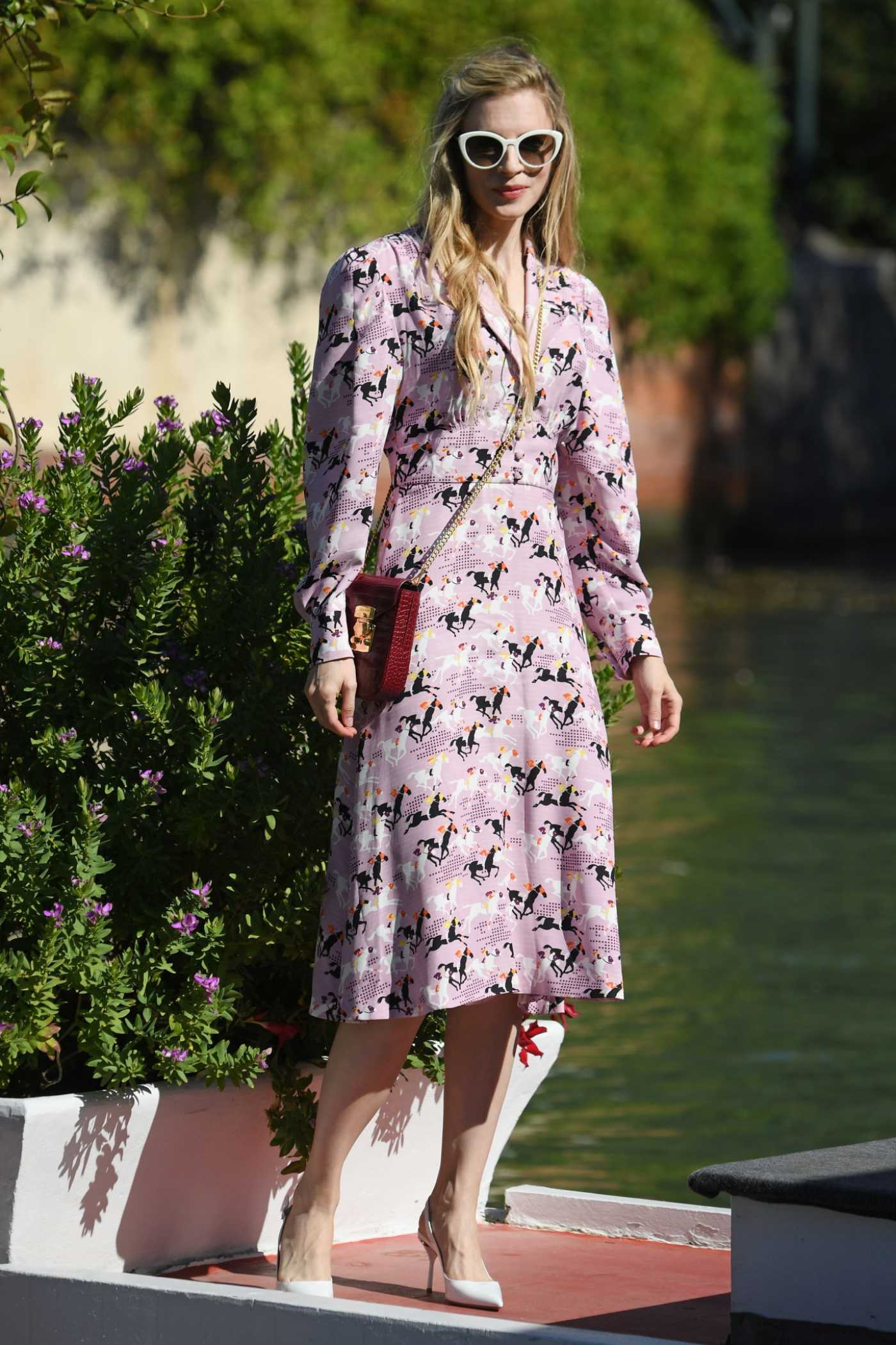 Brit Marling in a Purple Dress Arrives at the 76th Venice Film Festival in Venice 09/03/2019