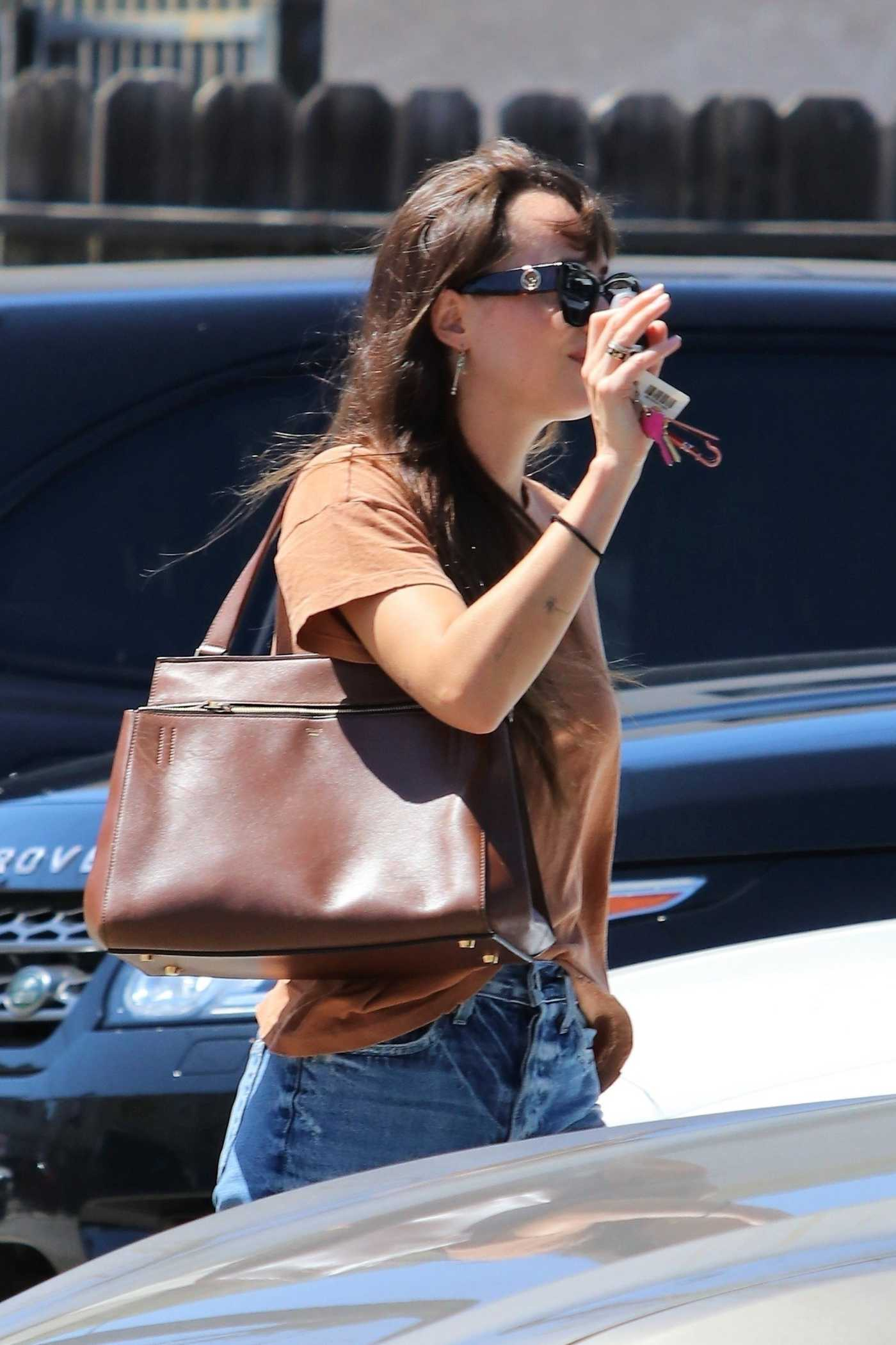 Dakota Johnson in a Brown Tee Leaves Nail Salon in Los Angeles 09/03/2019