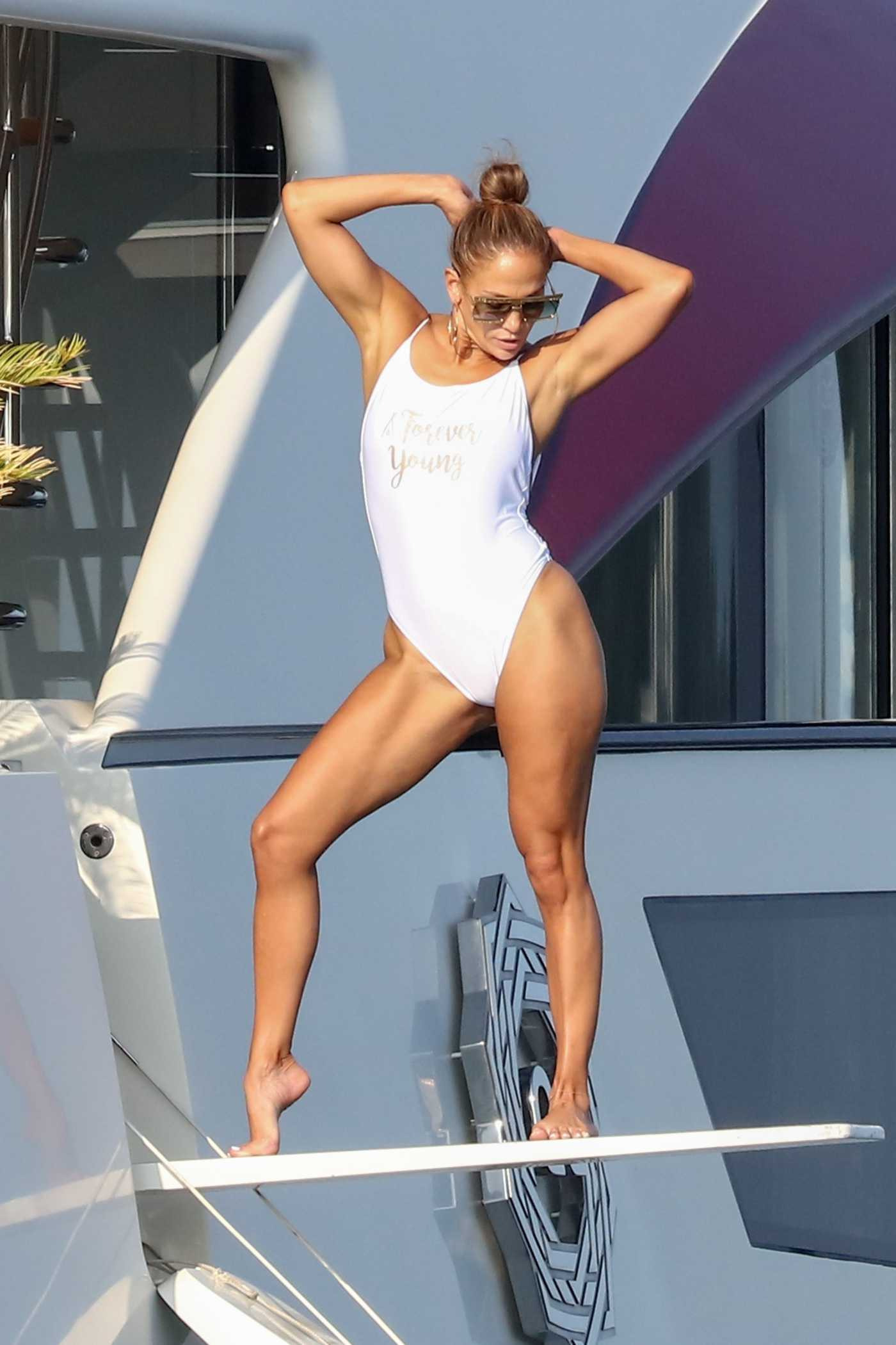 Jennifer Lopez in a White Swimsuit on a Yacht in St Tropez 09/03/2019