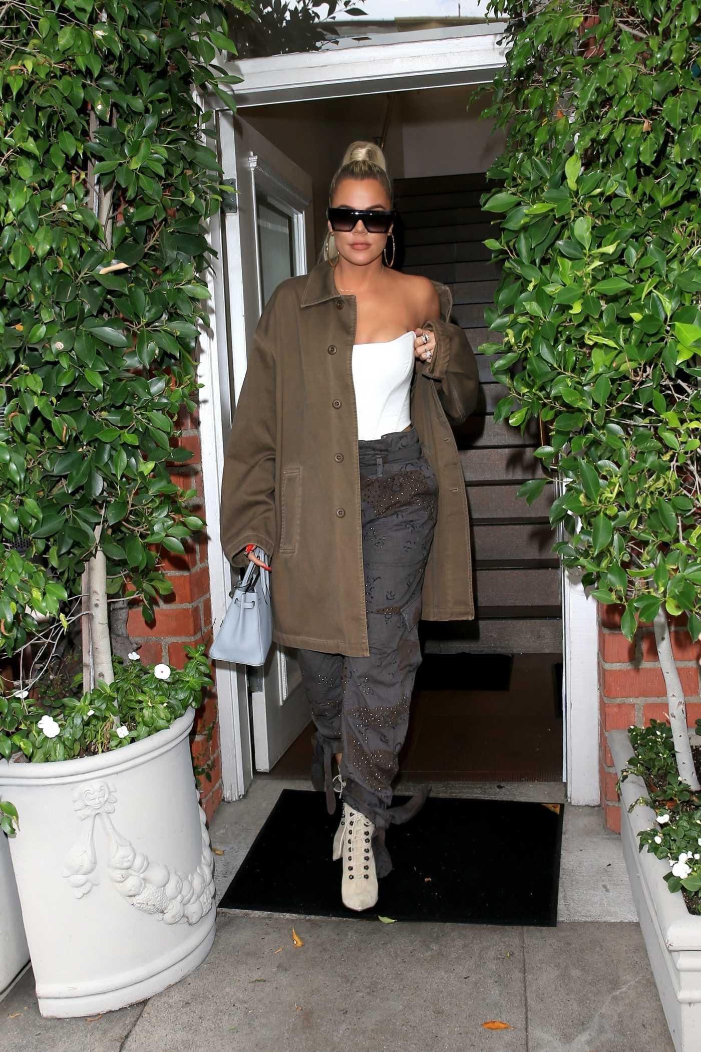 Khloe Kardashian in a Beige Trench Coat Out for Lunch in Los Angeles 09/26/2019
