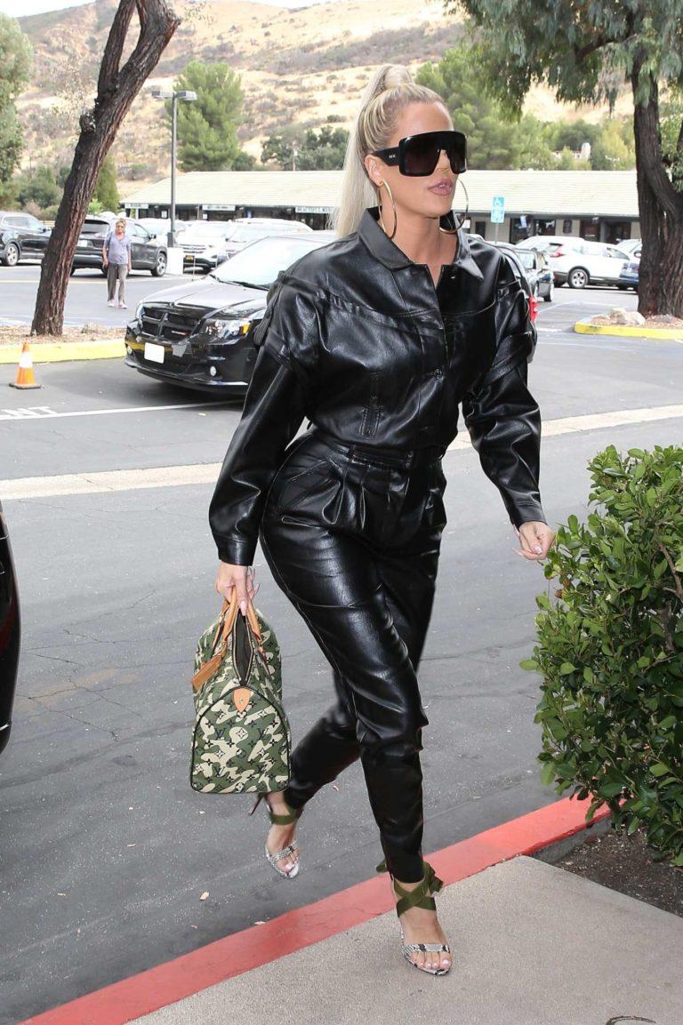 Khloe Kardashian in a Black Leather Jumpsuit