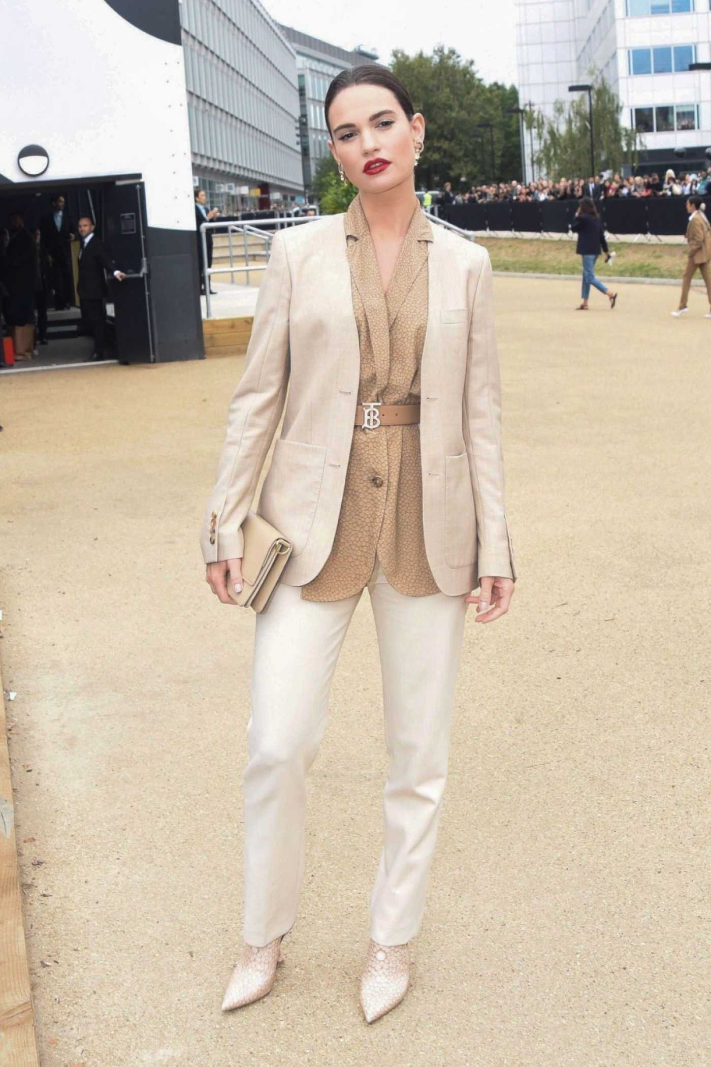 Lily James in a Beige Suit Arrives at the Burberry Fashion Show During 2019 London Fashion Week in London 09/16/2019