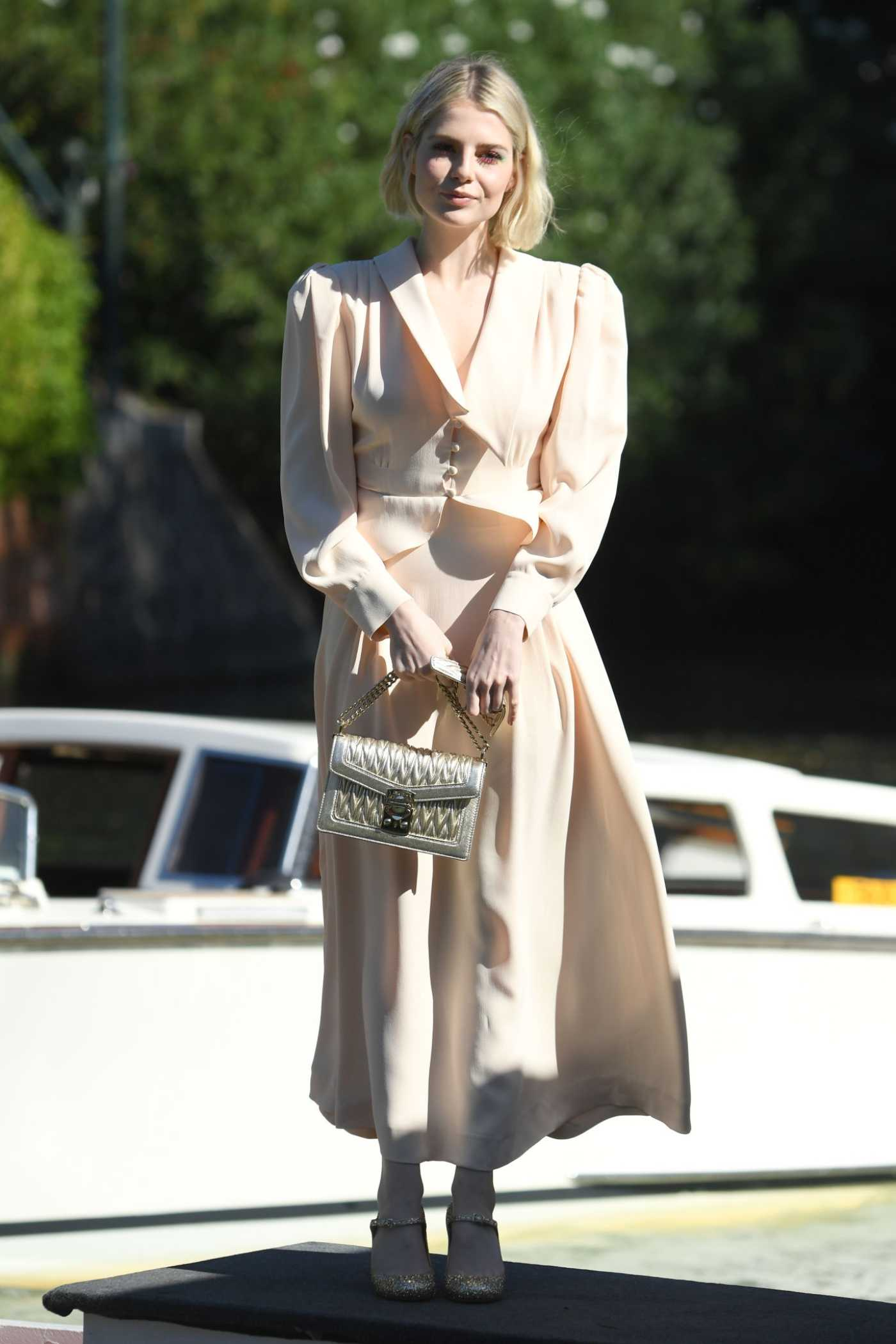Lucy Boynton in a Beige Suit Arrives at the 76th Venice Film Festival in Venice 09/03/2019