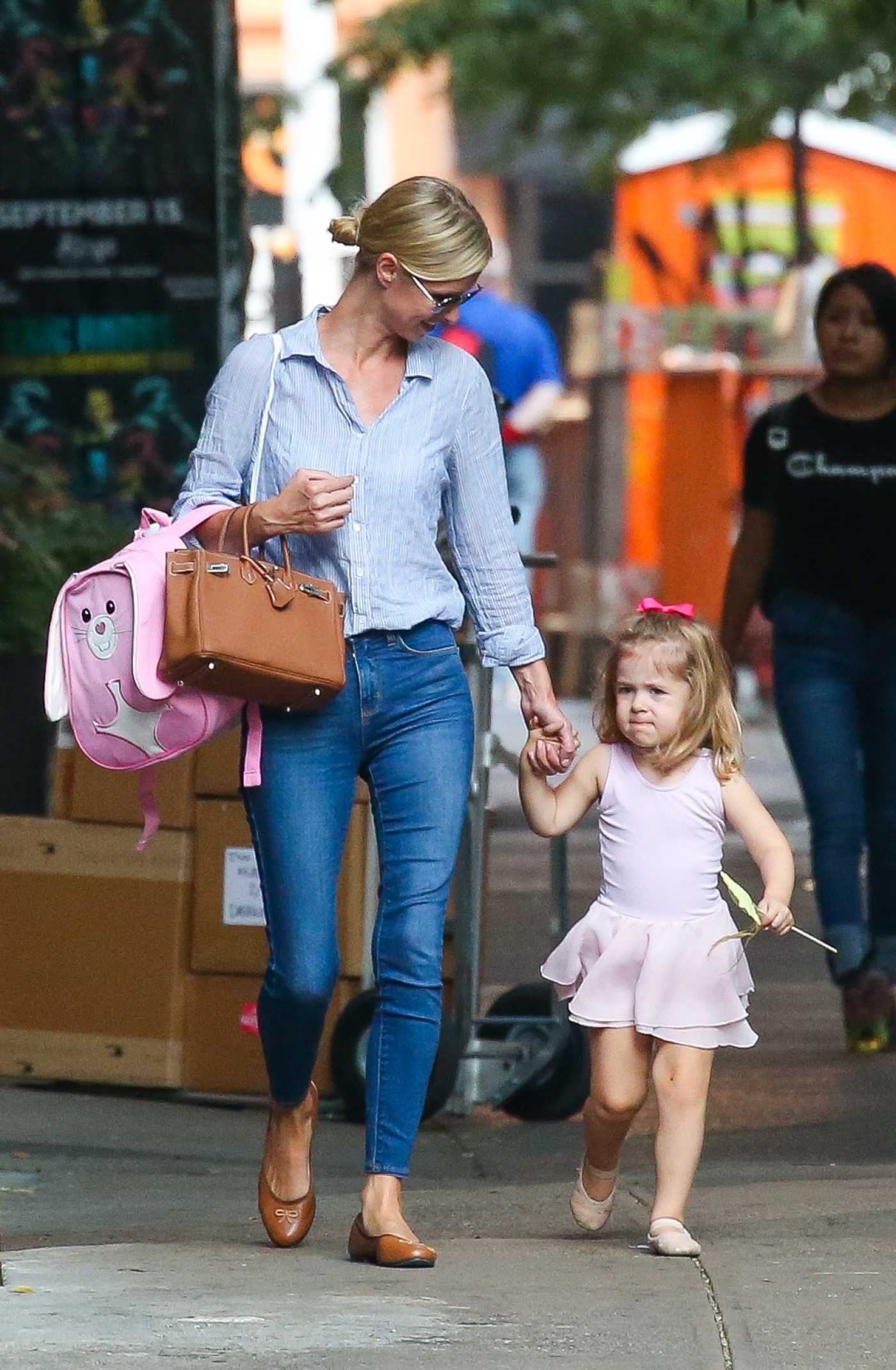 Nicky Hilton in a Blue Jeans Was Seen Out with Her Daughter in New York 09/11/2019