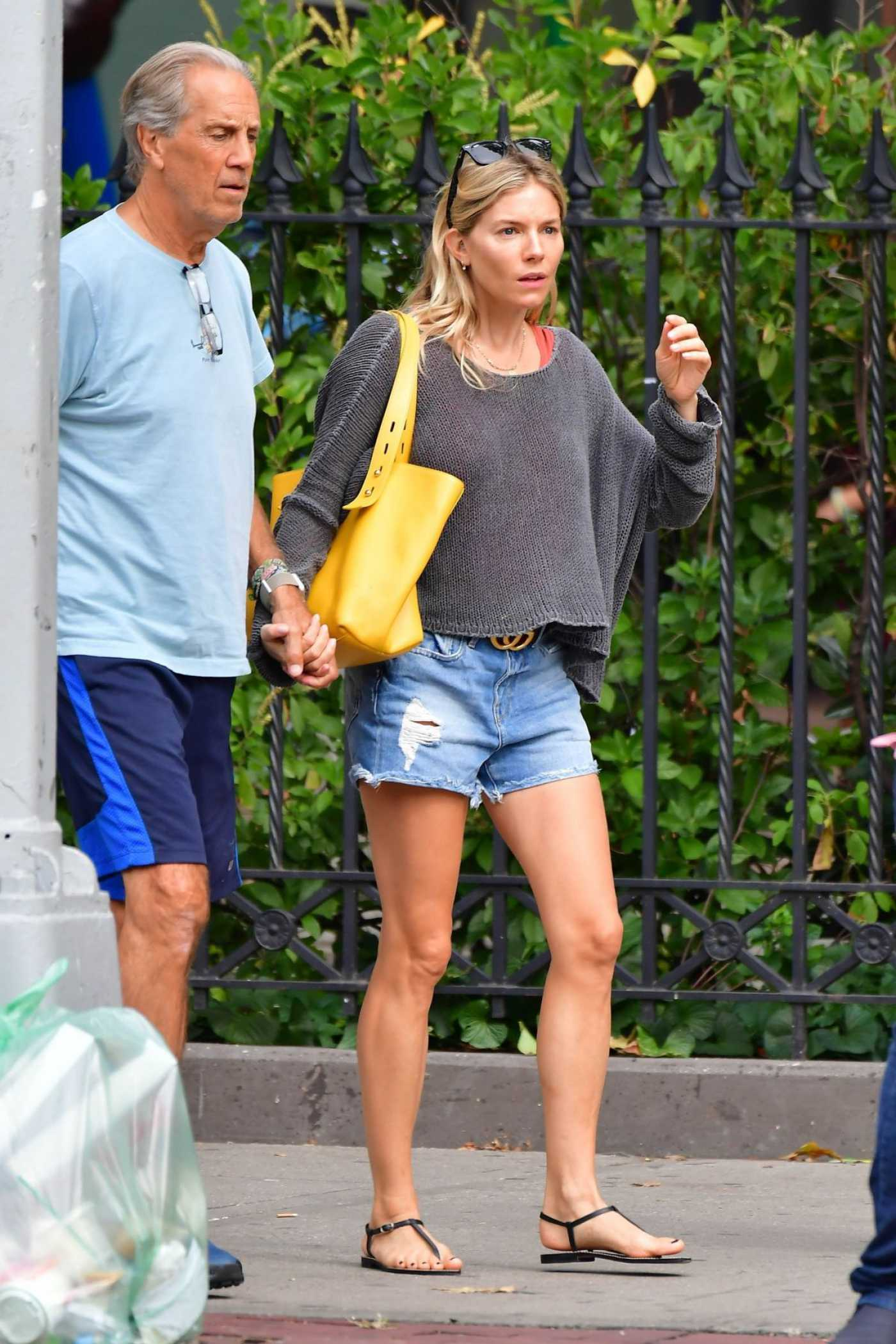 Sienna Miller in a Ripped Demin Shorts Was Seen Out in New York 09/05/2019